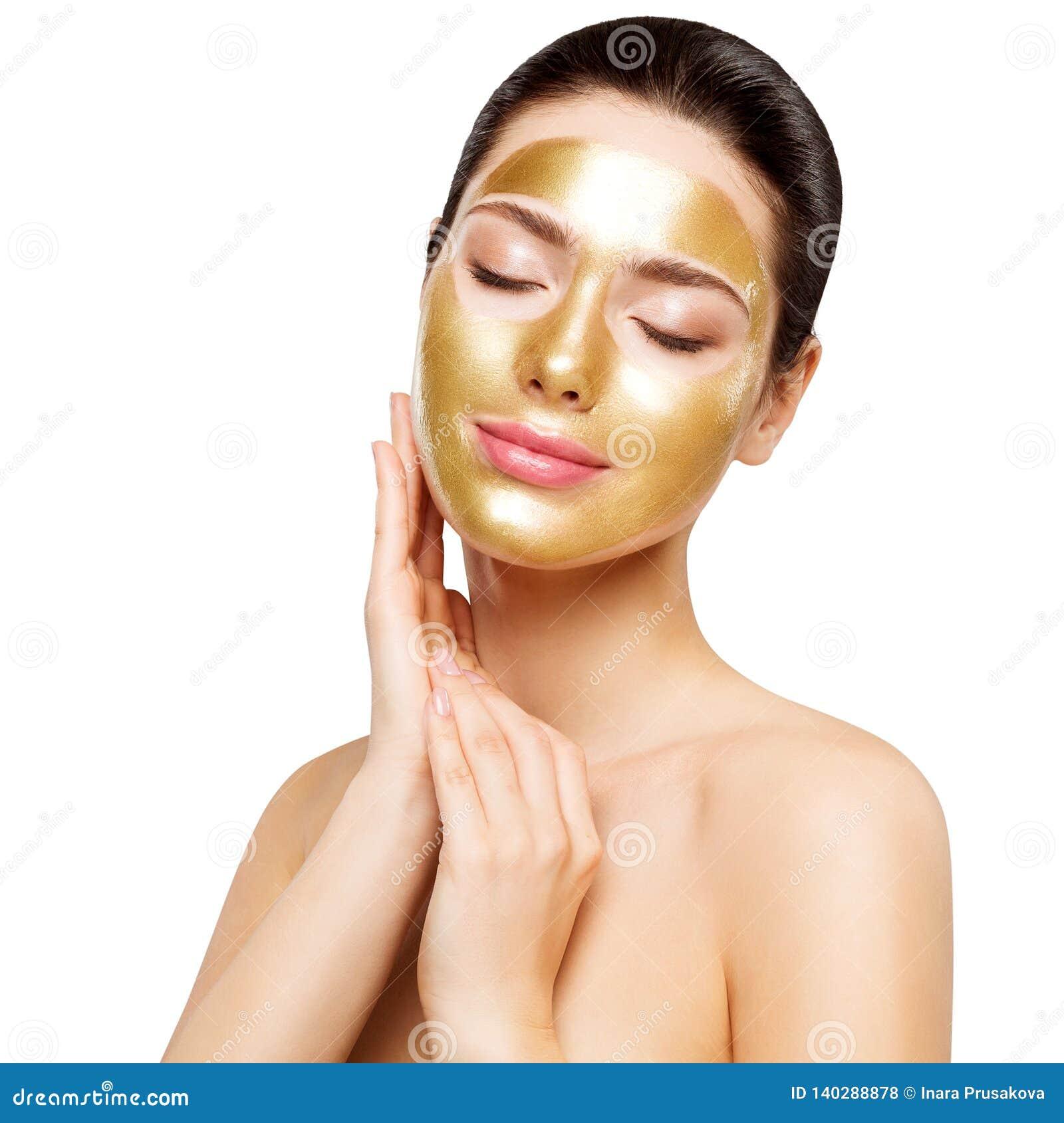 Máscara do ouro da mulher, modelo bonito com a cara cosmética do toque da pele dourada, beleza Skincare e tratamento