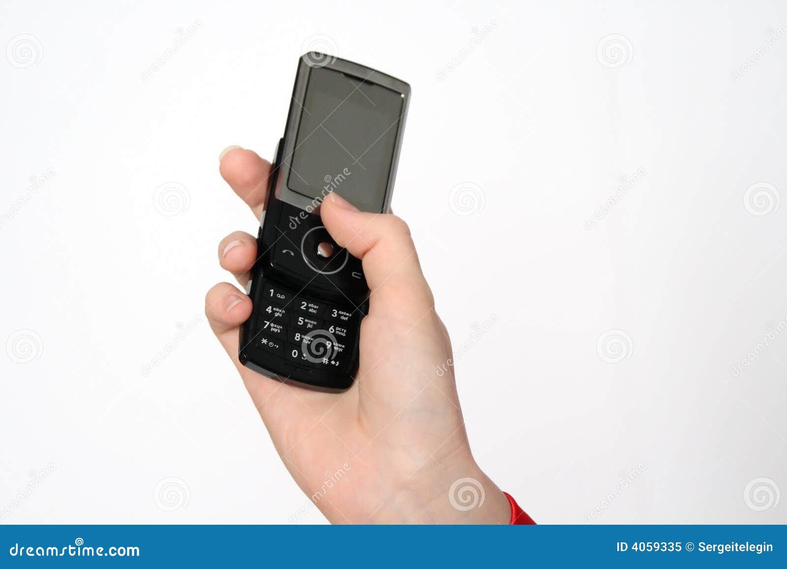Mão com um telefone móvel