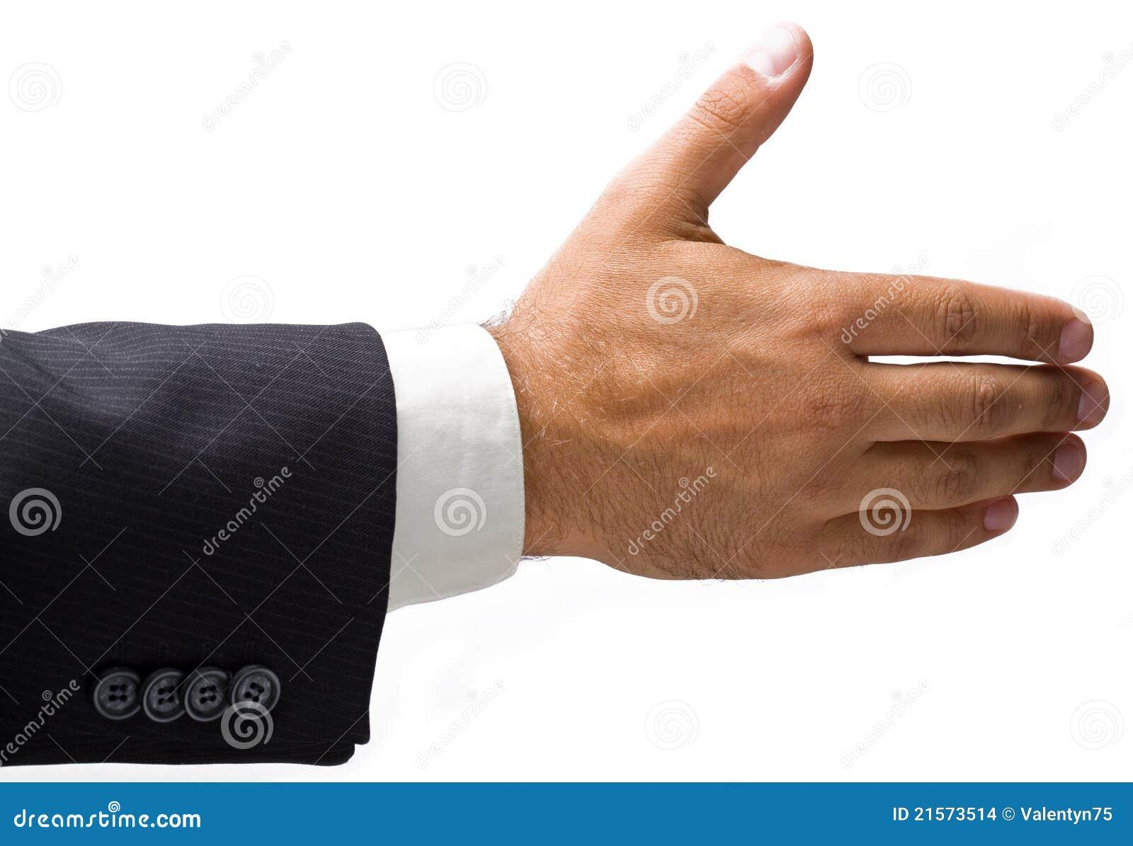 Mão do homem de negócios prolongado para um aperto de mão.