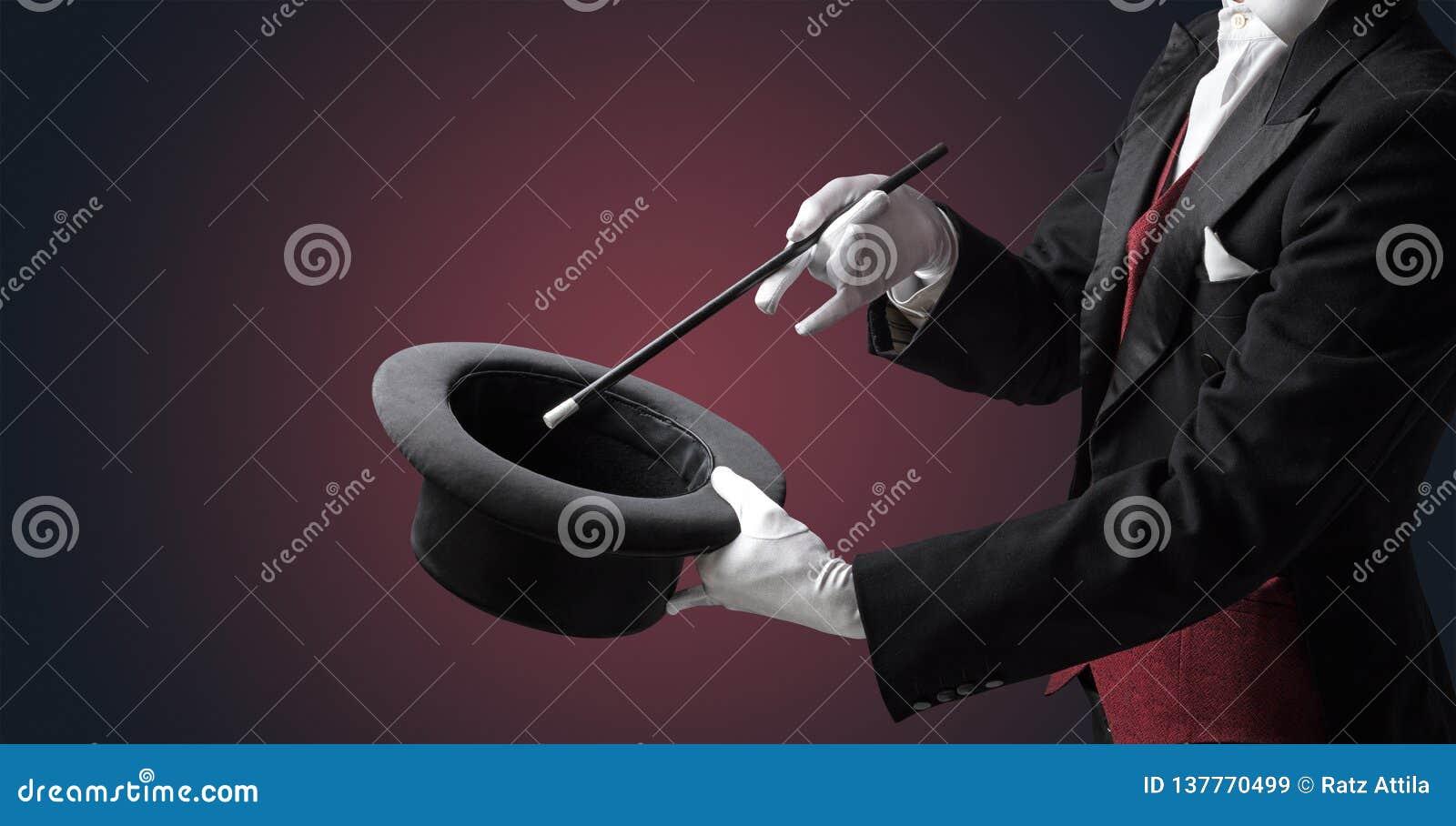 A mão do ilusionista quer s conjurar algo