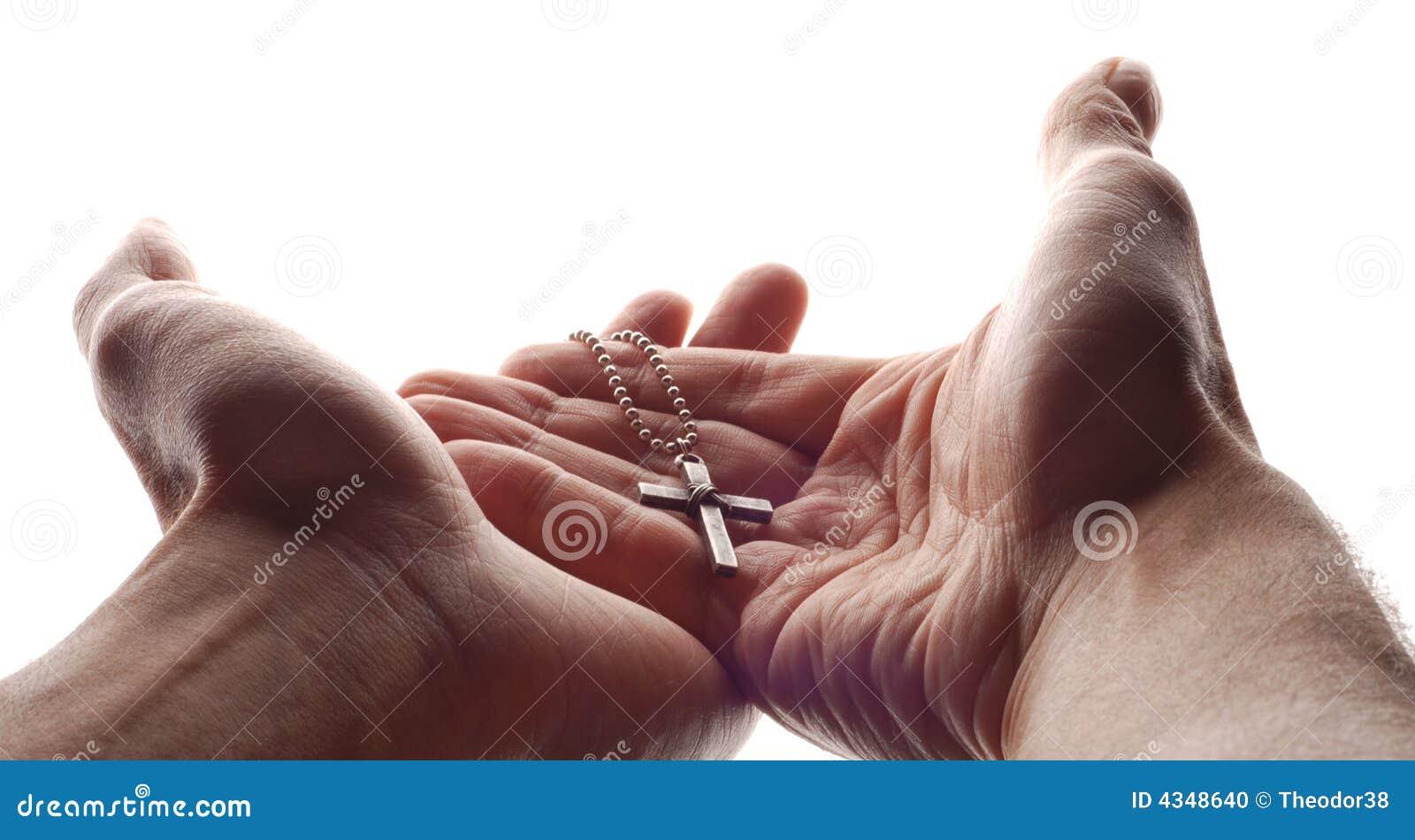Mão e cruz