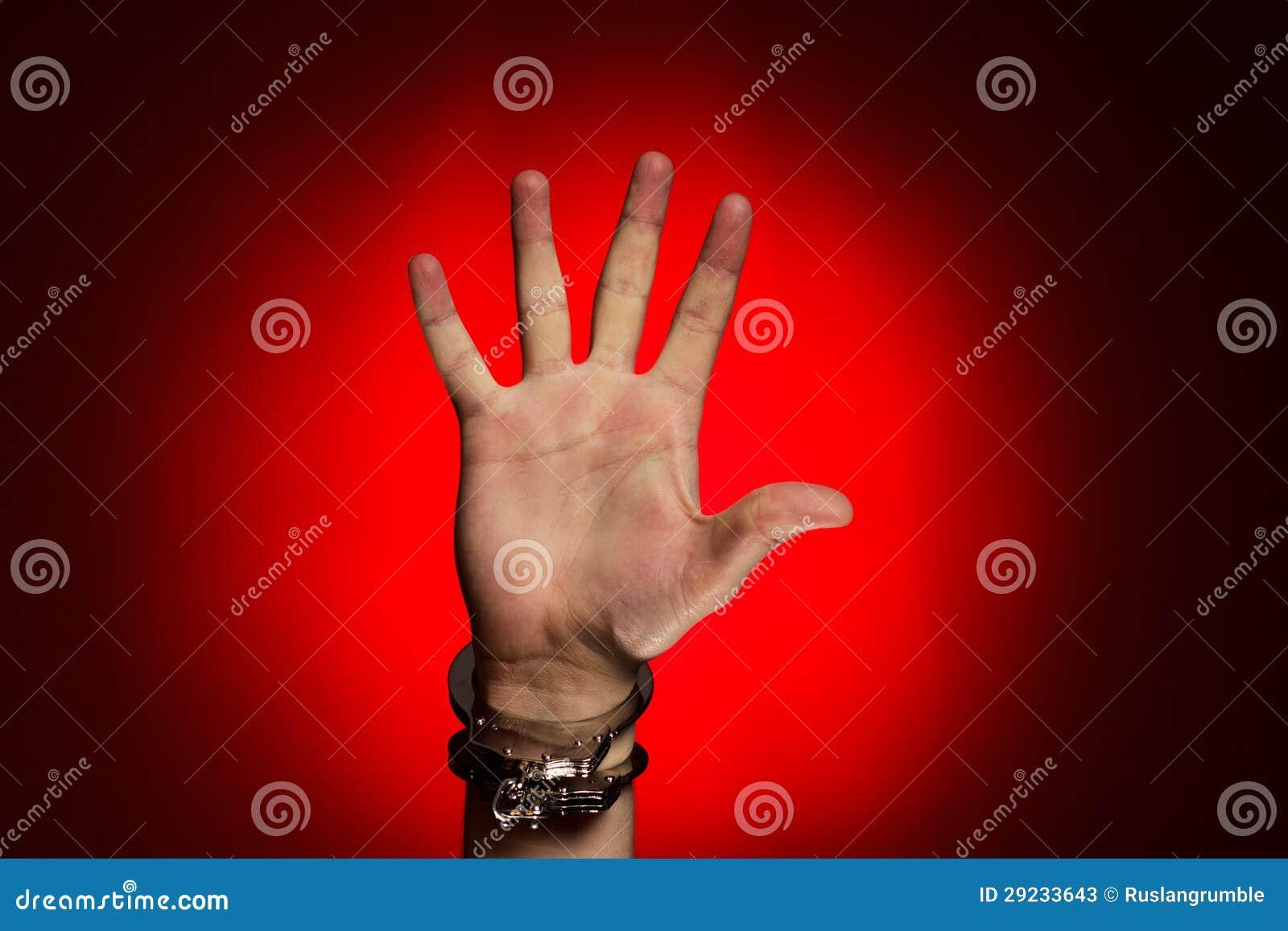 Download Mão Nas Algemas Sobre O Fundo Vermelho Imagem de Stock - Imagem de negócio, suspicious: 29233643