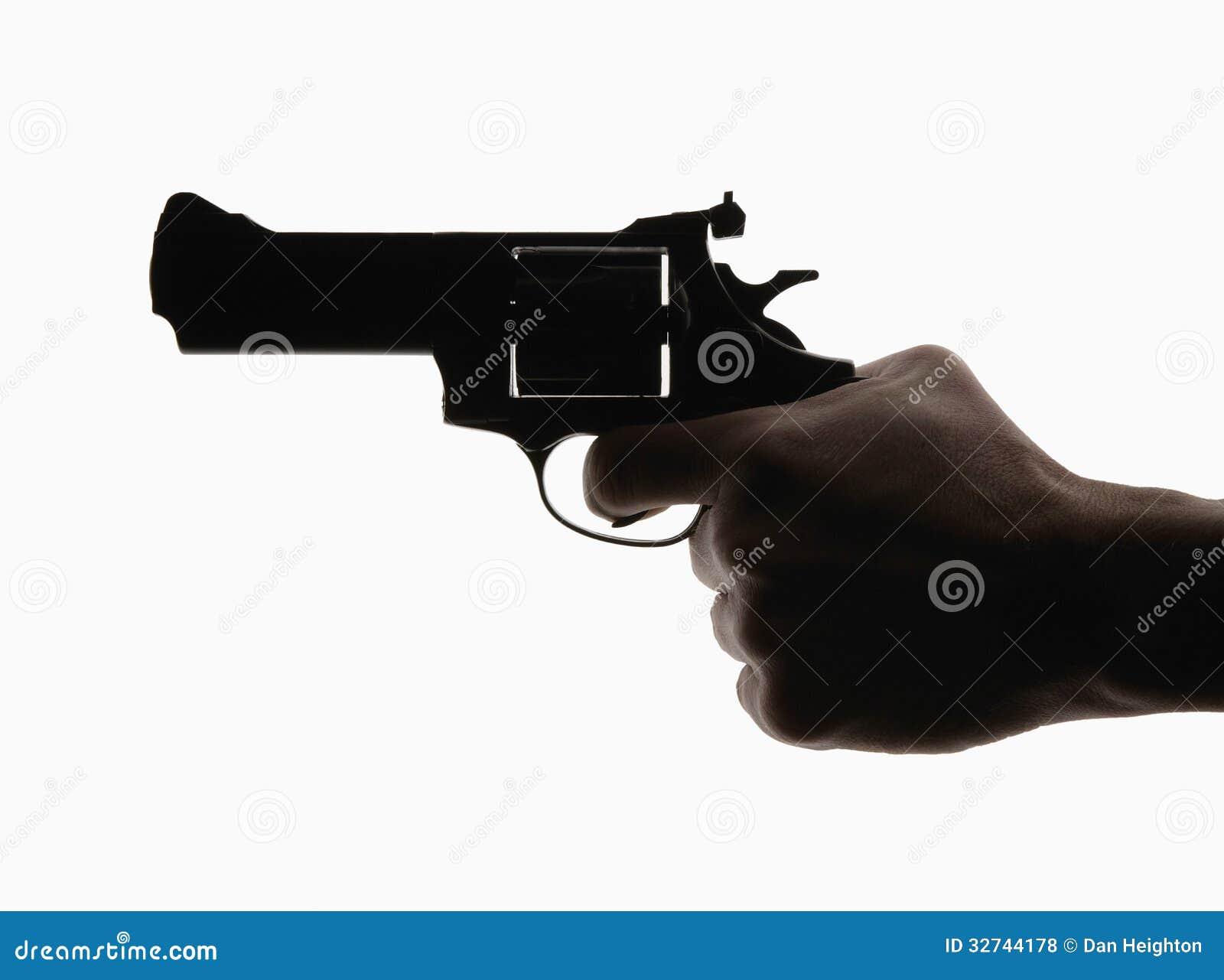 Mão que guarda o revólver