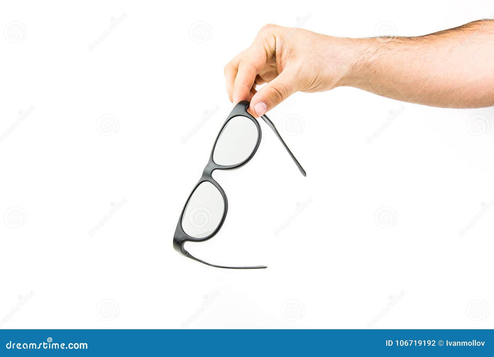 Mão que guarda vidros da tevê 3D
