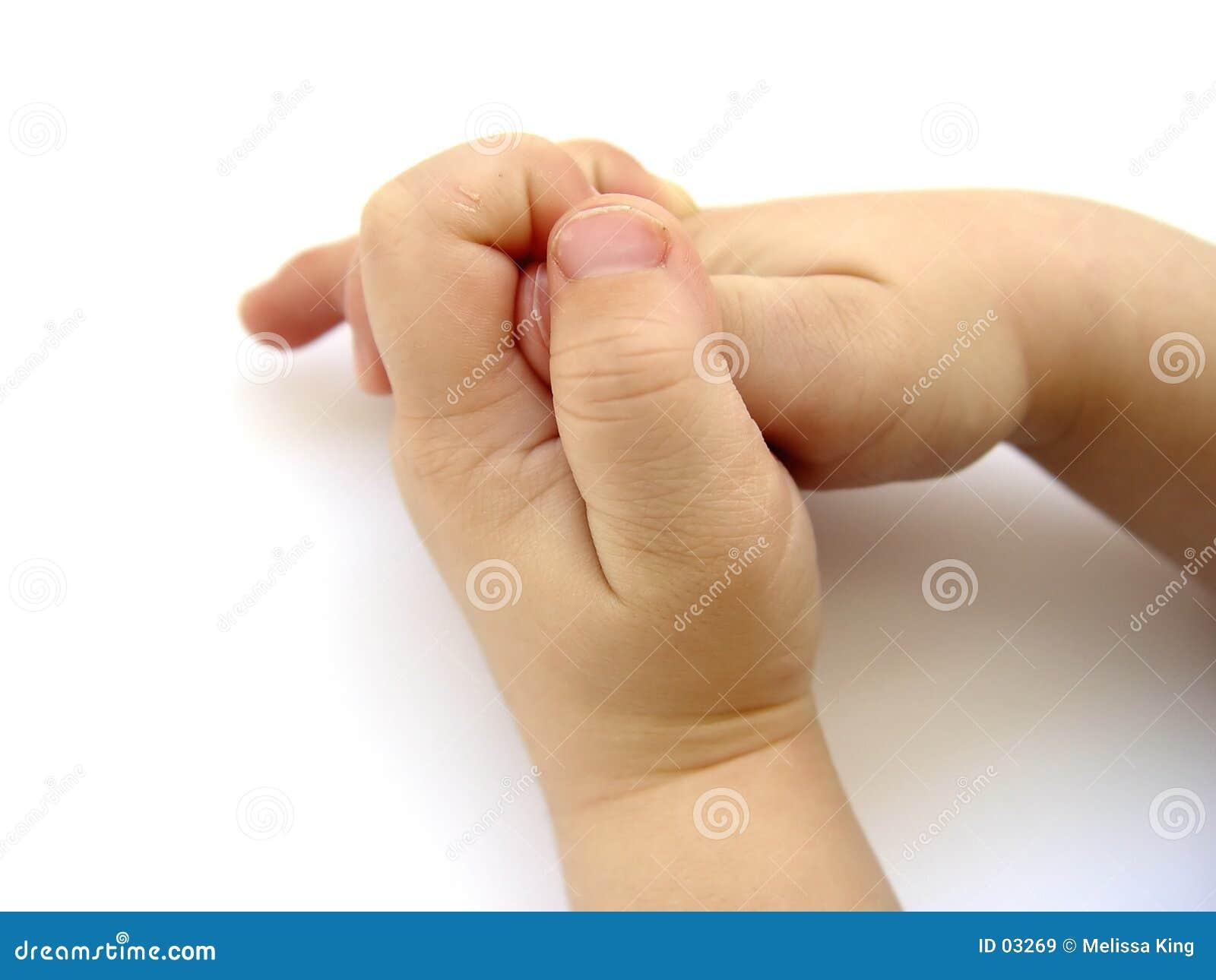 Mãos dos rapazes pequenos II