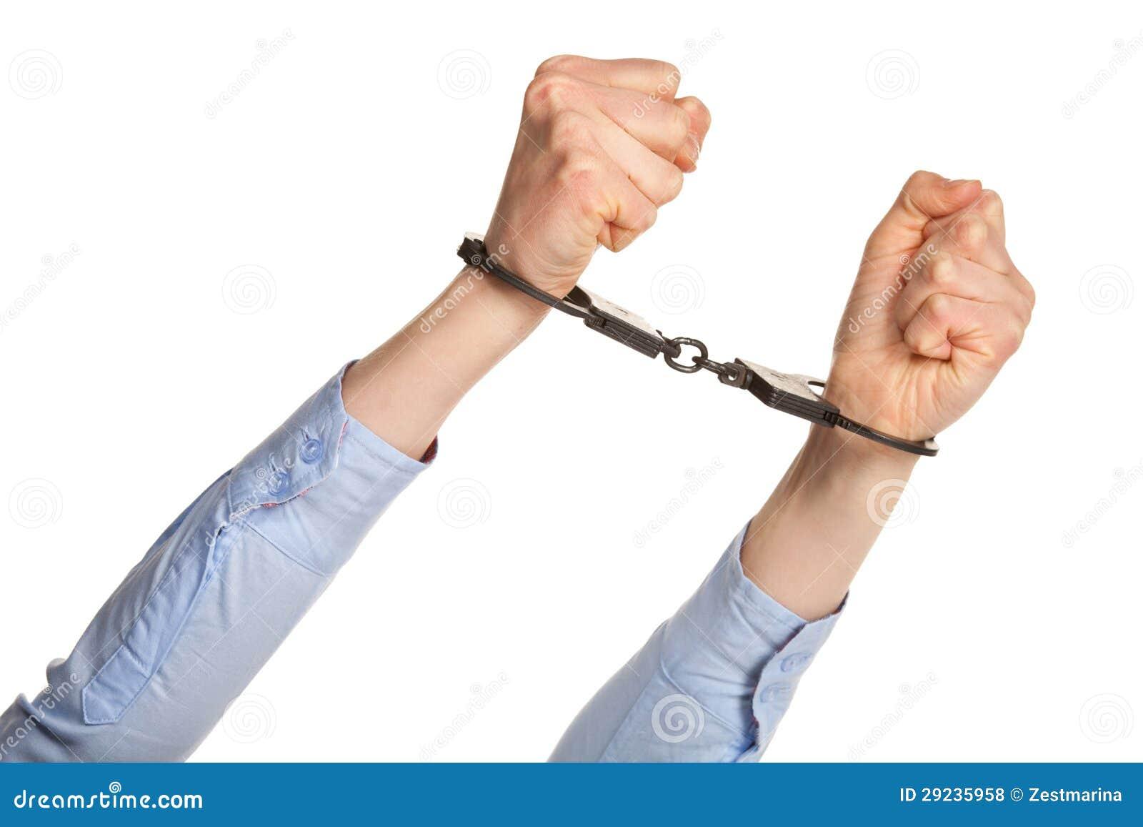 Download Mãos nas algemas foto de stock. Imagem de dedos, handcuff - 29235958