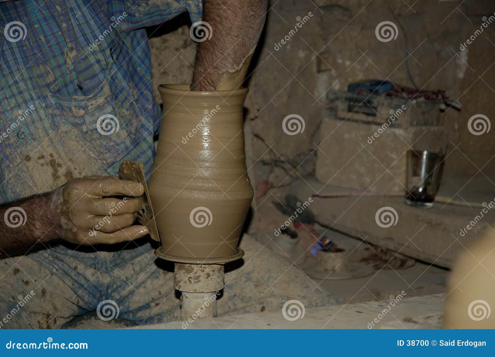 Mãos talentosos do oleiro mim