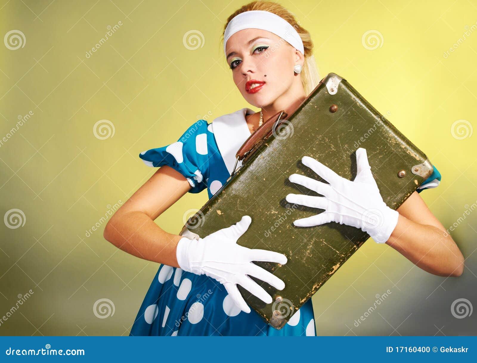 Mädchen mit einem Koffer