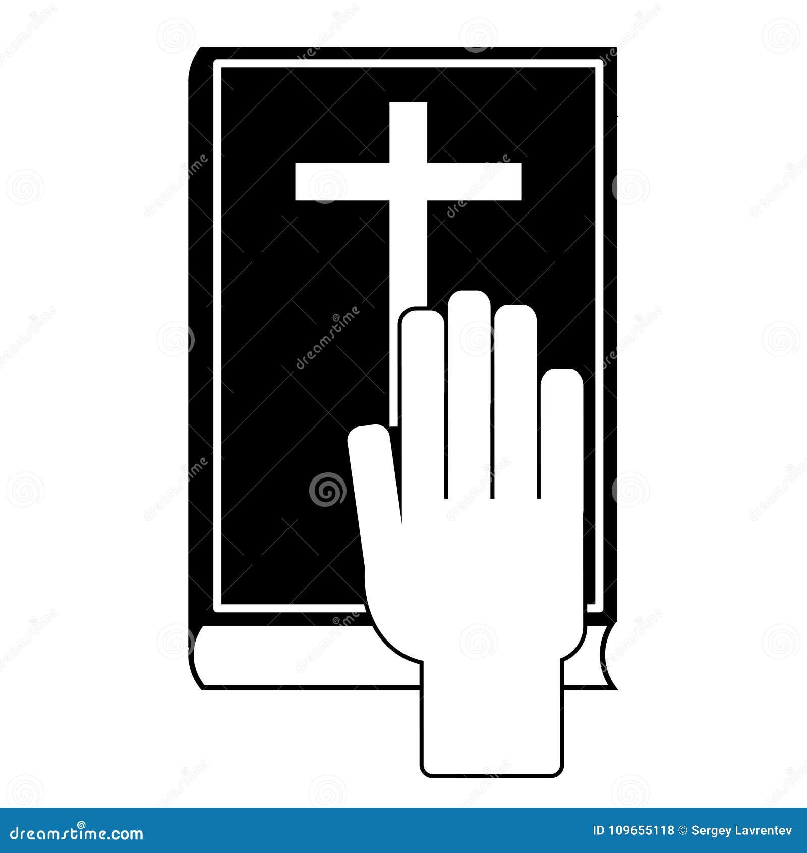 Mänsklig hand på bibeln
