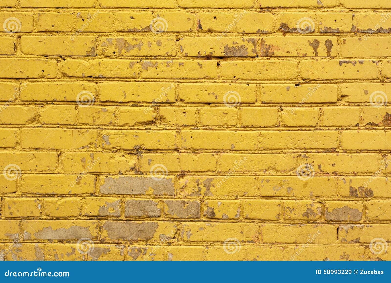 Målad gul textur för bakgrund för tegelstenvägg i ljusa toner