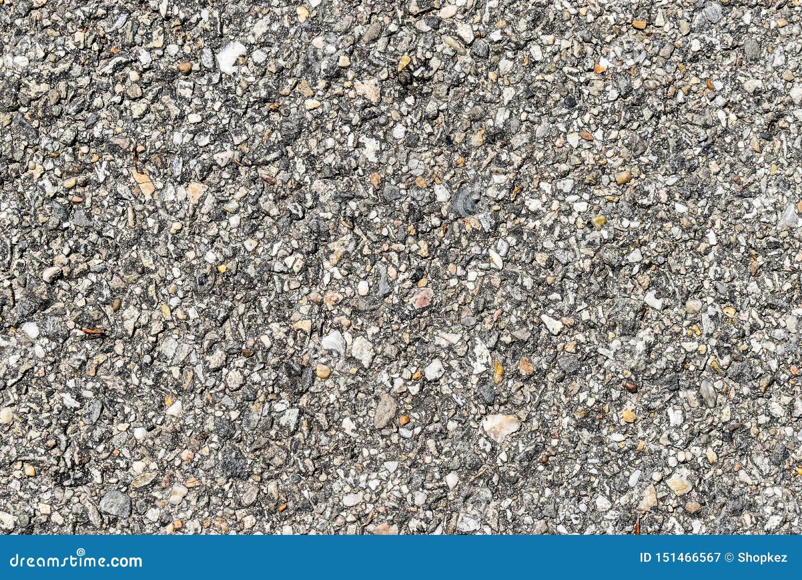 Många små stenar texturerar bakgrund Små grå färger stenar textur som är användbar för kopieringsutrymme, bakgrunder eller konstv