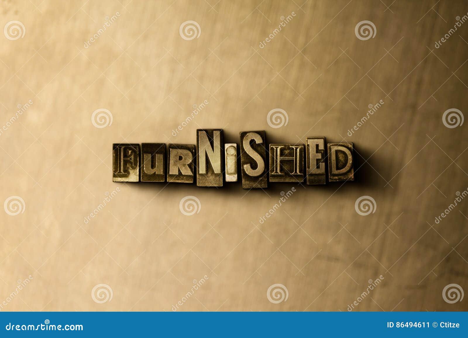 MÖBLERAT - närbild av det typsatta ordet för grungy tappning på metallbakgrunden