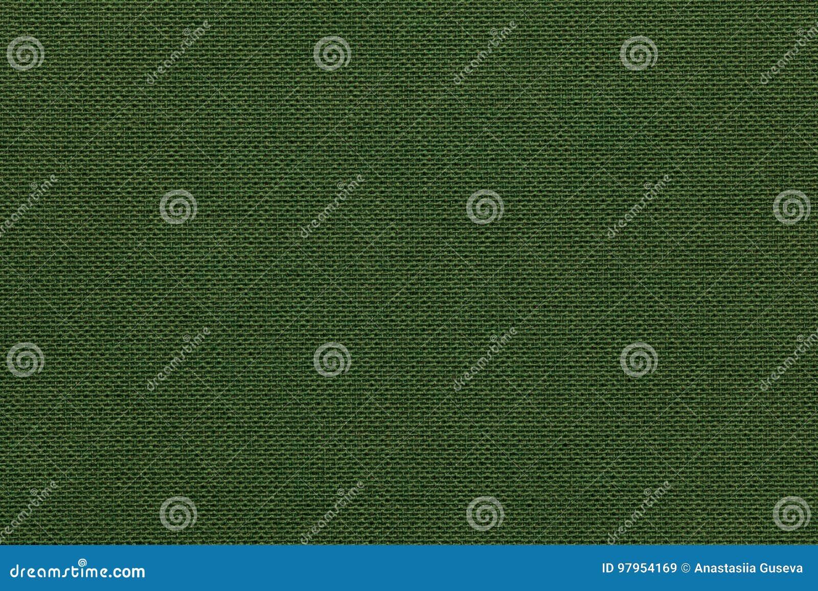 Mörker - grön bakgrund från ett textilmaterial med den vide- modellen, closeup