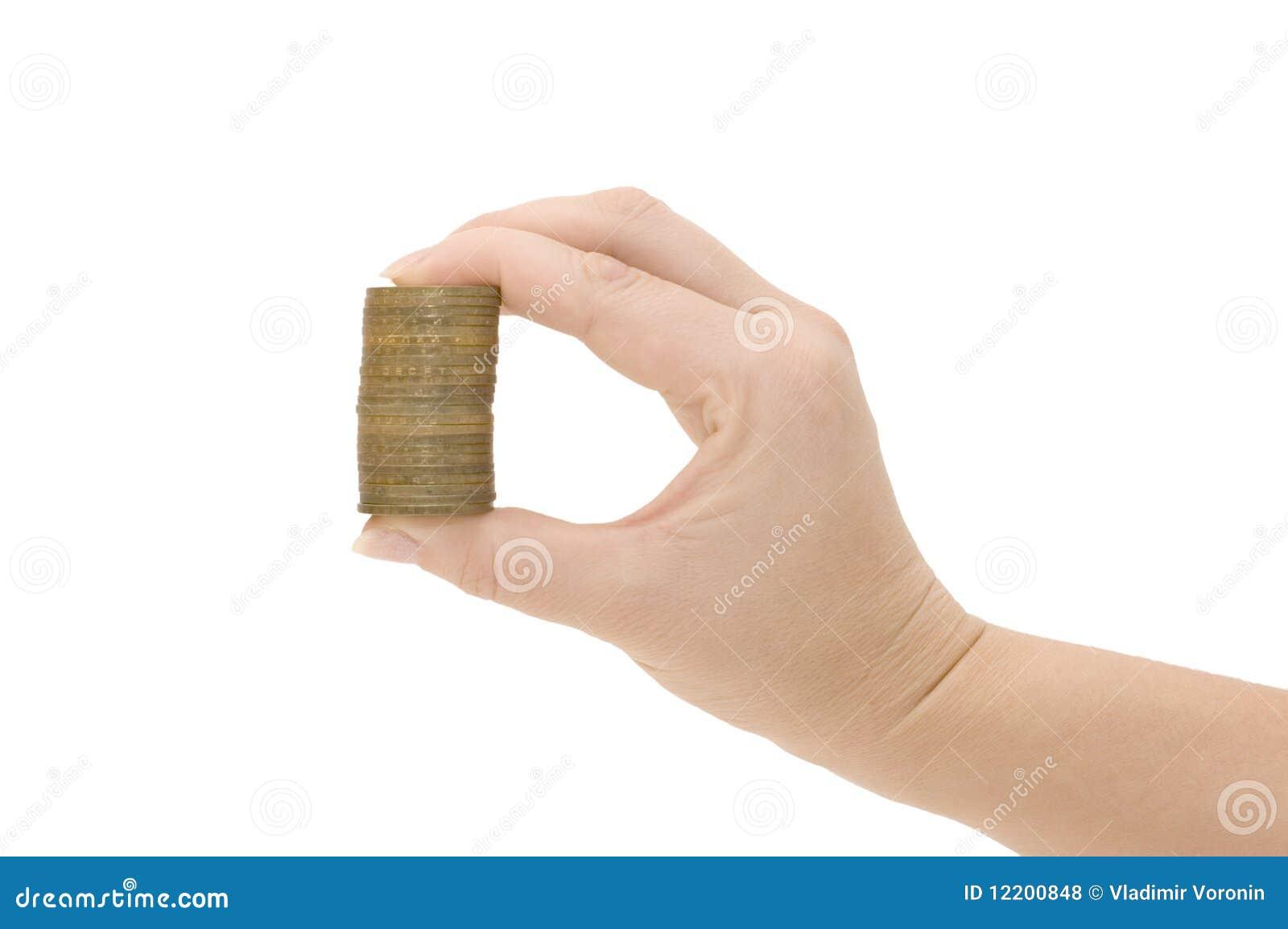 Münzen in einer weiblichen Hand