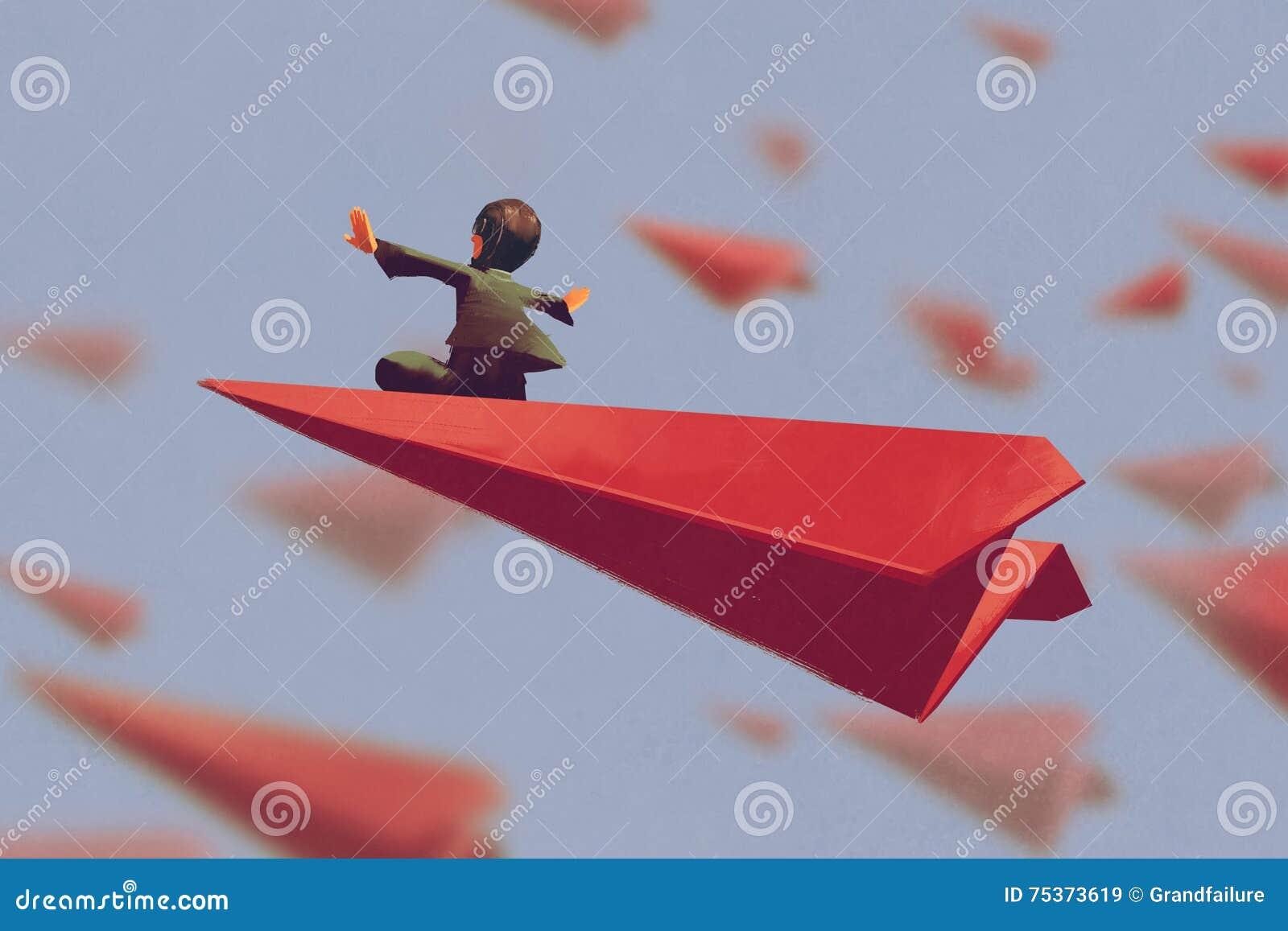 Mężczyzna obsiadanie na czerwonym samolotu papierze