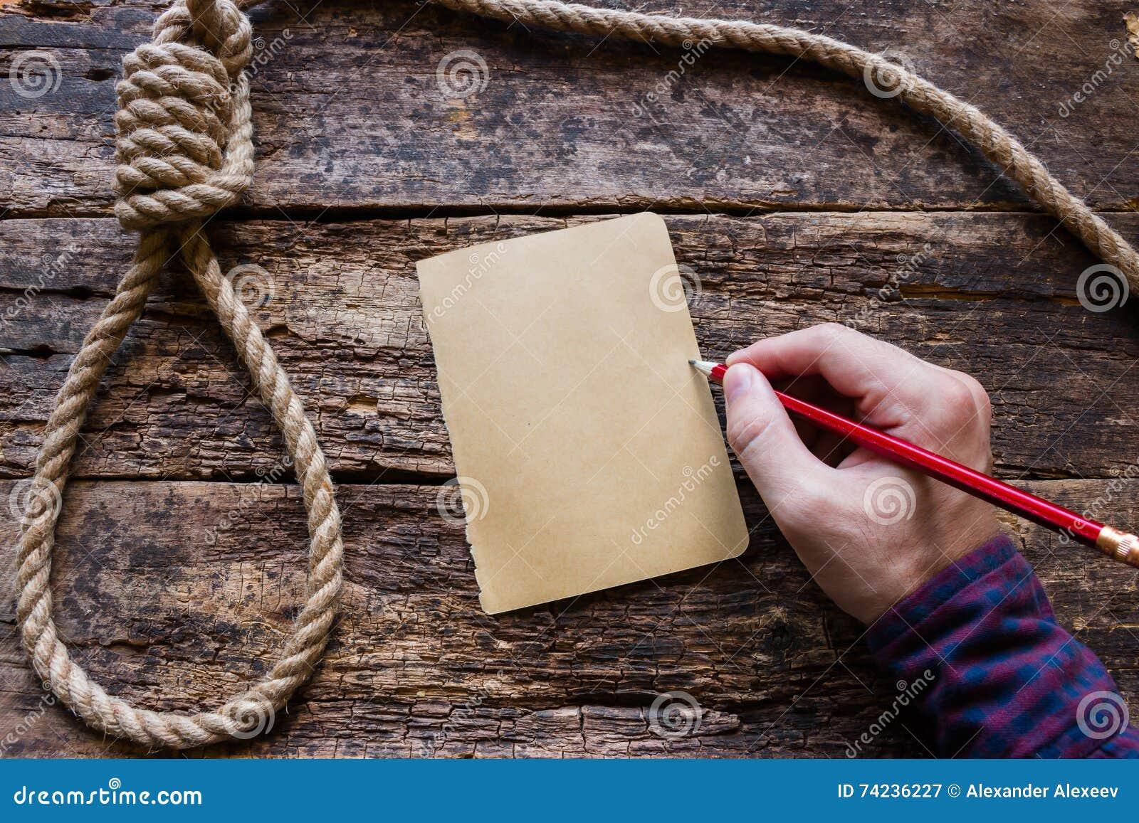 Mężczyzna pisze liście samobójcy