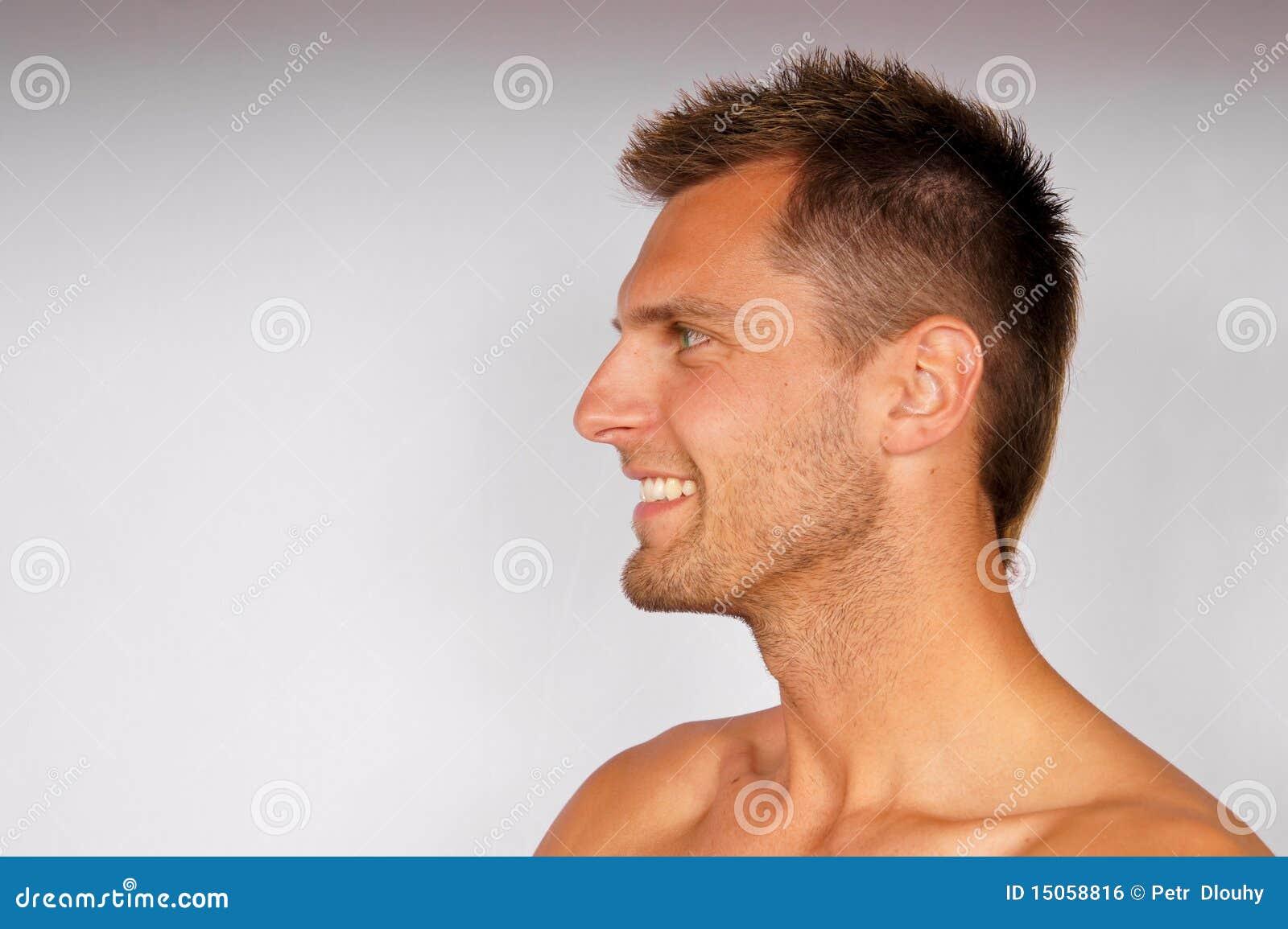Mężczyzna potomstwa profilowi uśmiechnięci