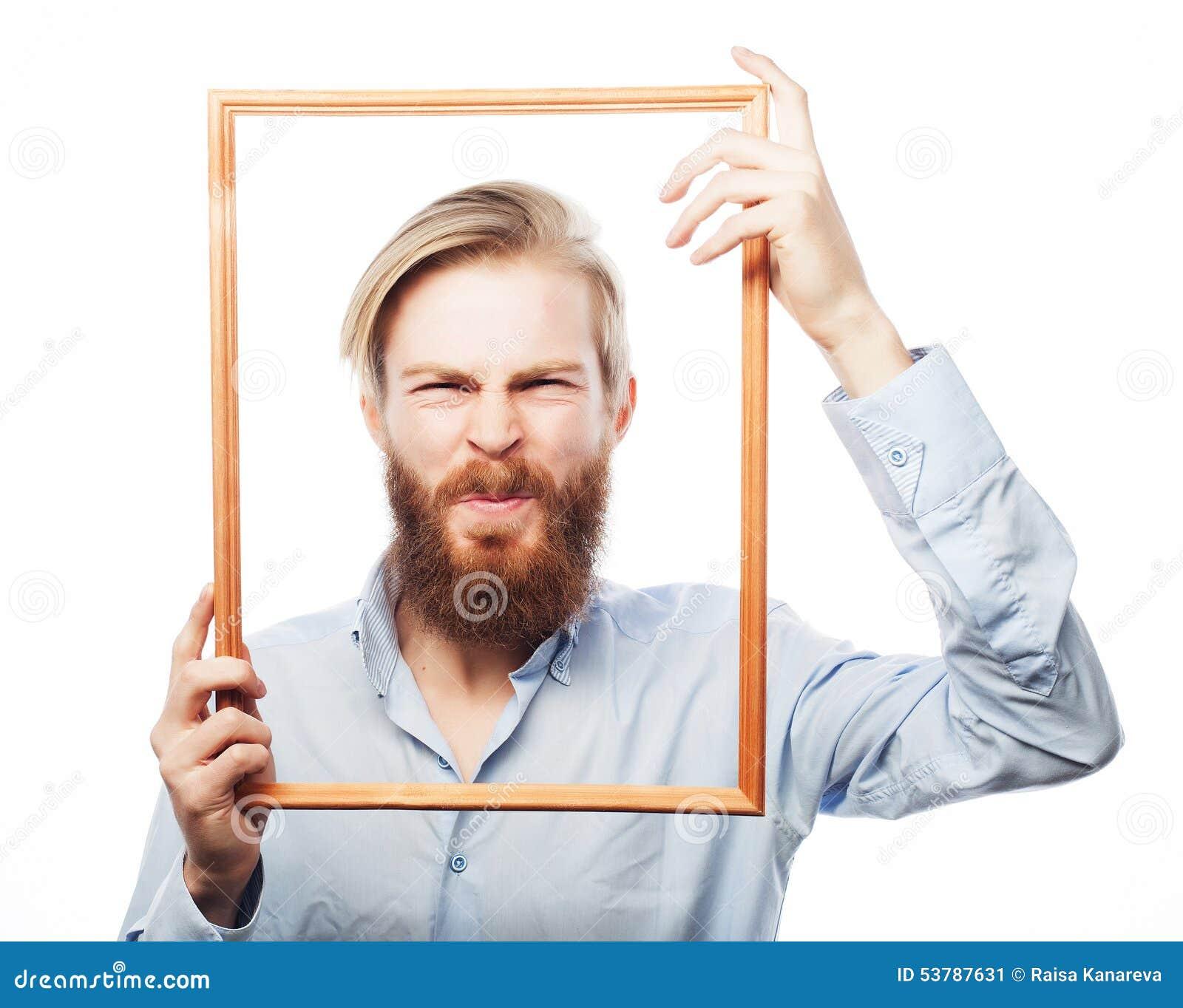 Młodego człowieka mienia obrazka rama