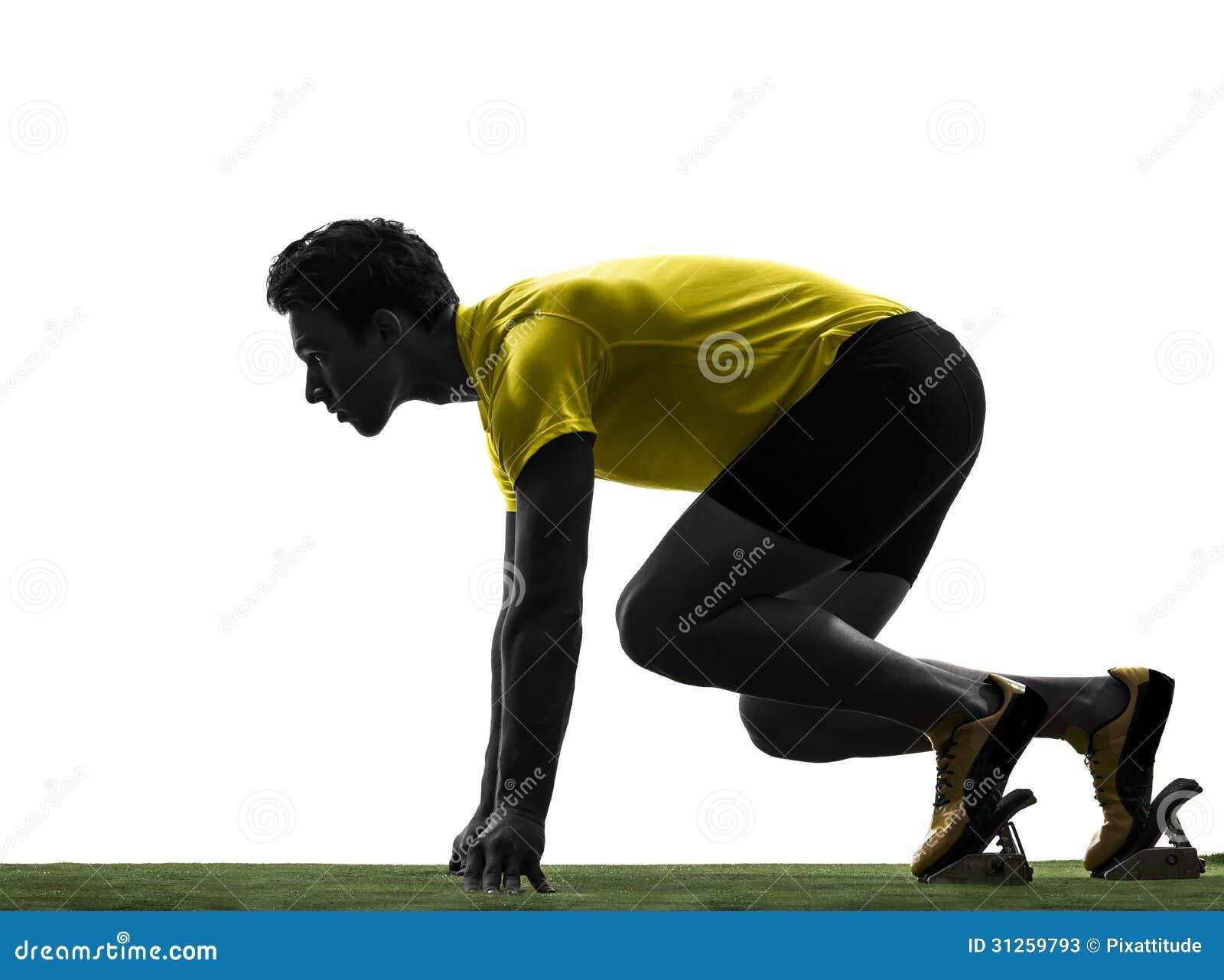 Młodego człowieka szybkobiegacza biegacz w zaczyna bloków sylwetce