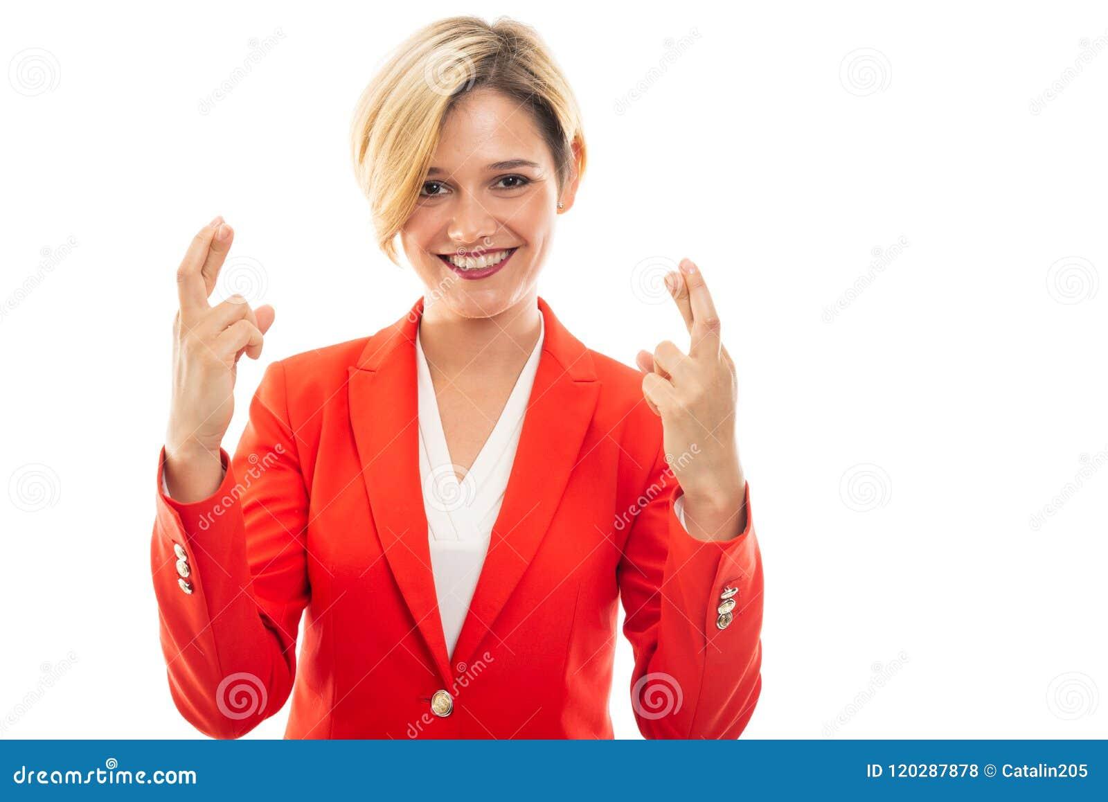 Młodzi ładni biznesowej kobiety seansu kopii palce krzyżujący