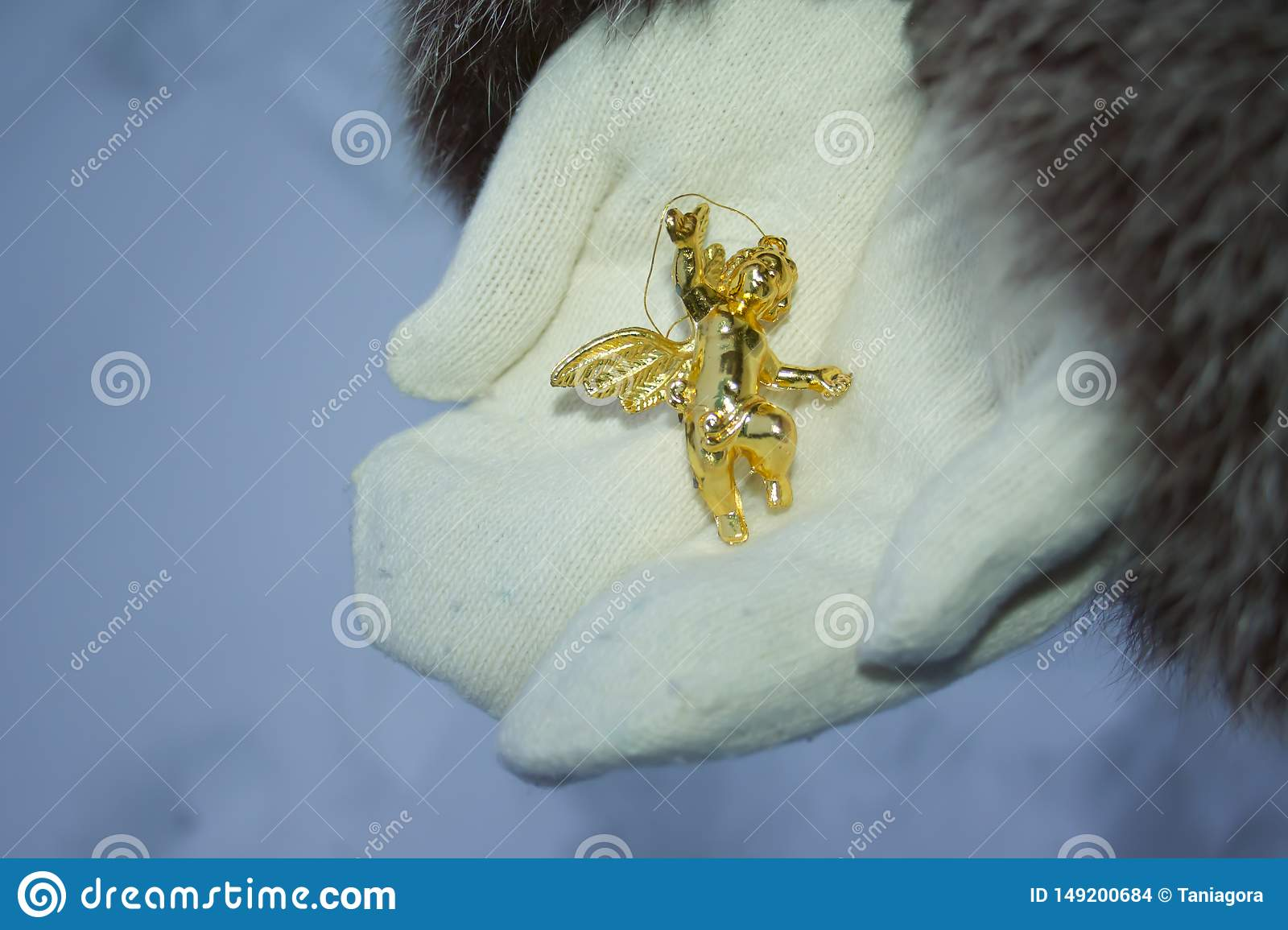 Glittering angel in mittens. Idea of merry and happy new