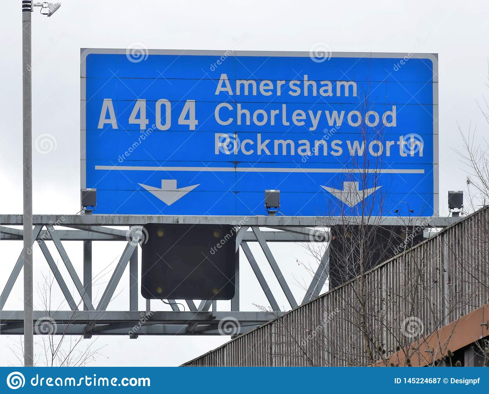 M25 Motorway exit sign at Junction 18 for Amersham, Chorleywood and Rickmansworth