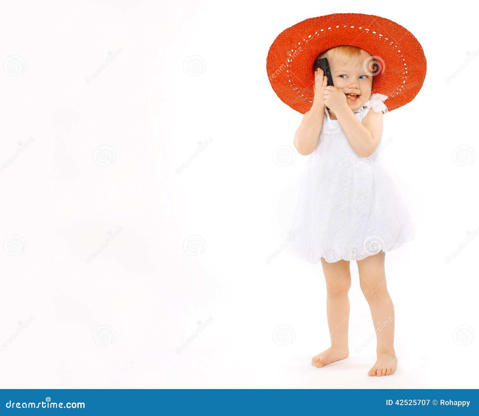 Mały rozochocony dziewczyny dziecko w czerwonym kapeluszu