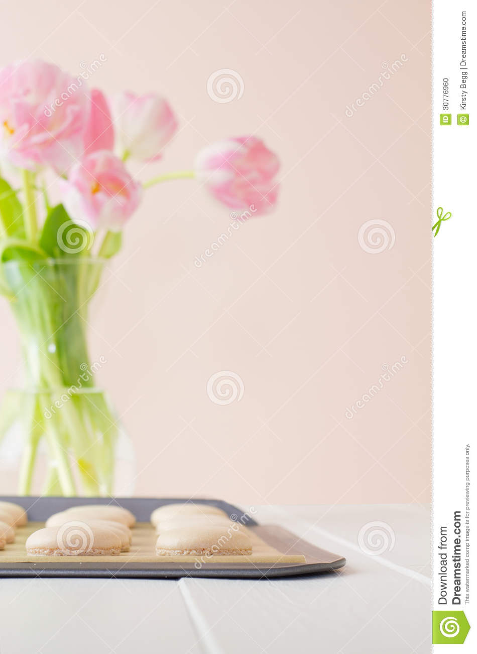 Macarons On Baking Sheet With Tulips Stock Photo - Image: 30776960