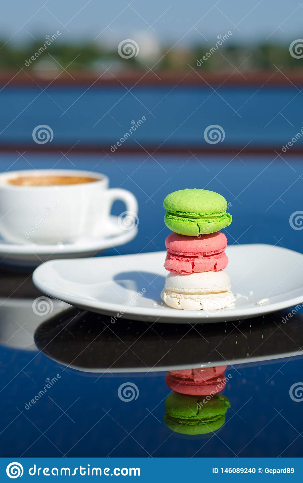 Macaroon dessert and coffee on the table