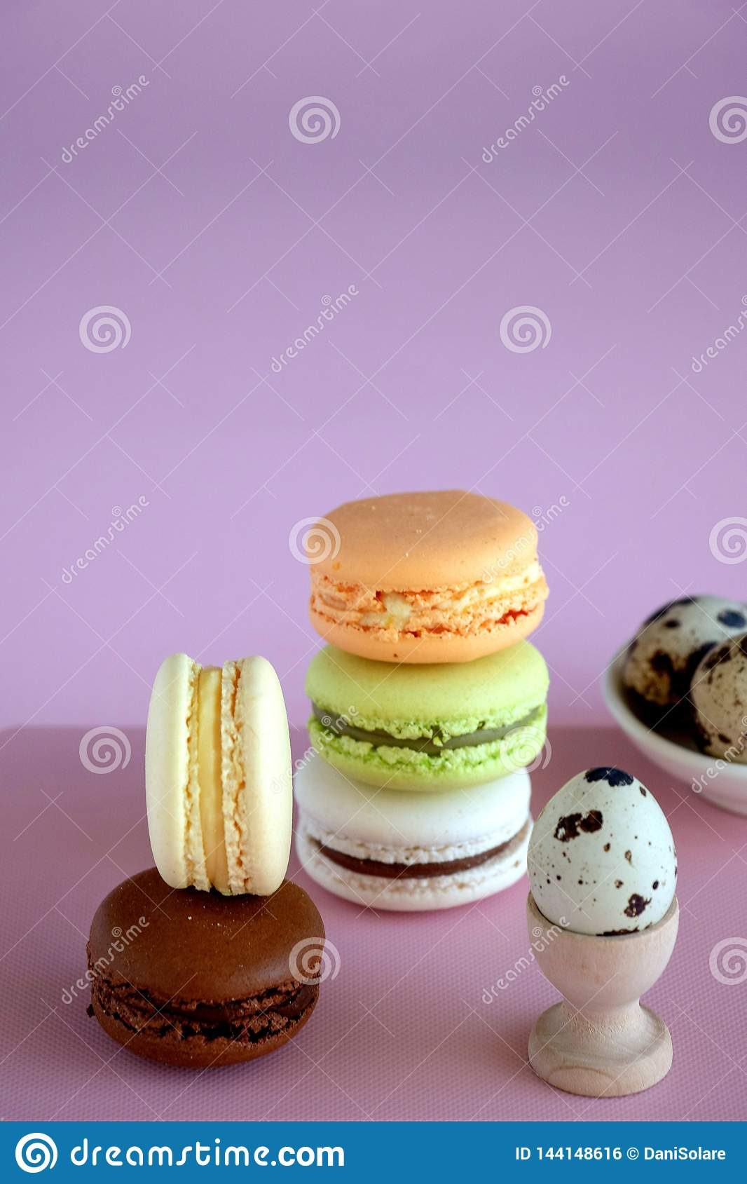 Macaroons on a pink background.