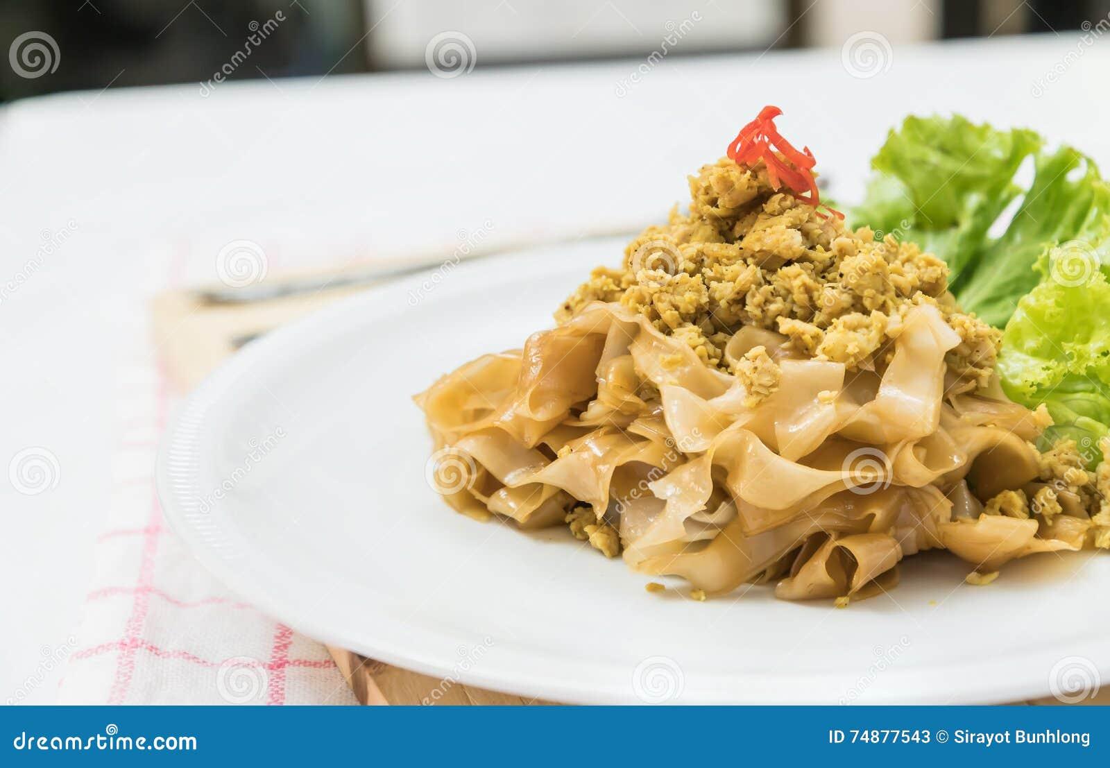 Macarronete de arroz fritado da agitação com carne de porco (a almofada vê Eiw)