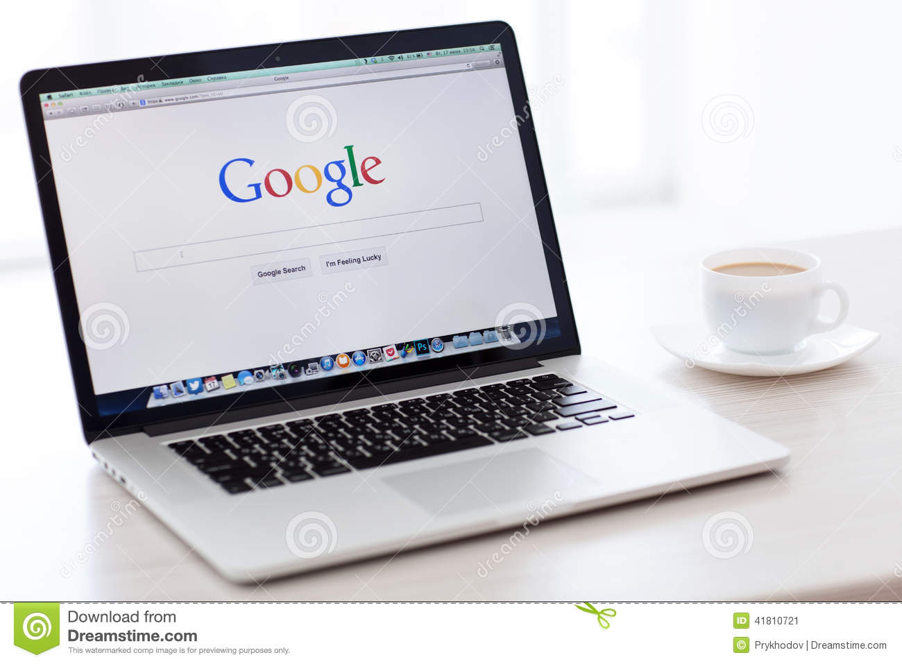 Macbook pro retina with google home page on the screen stands on.