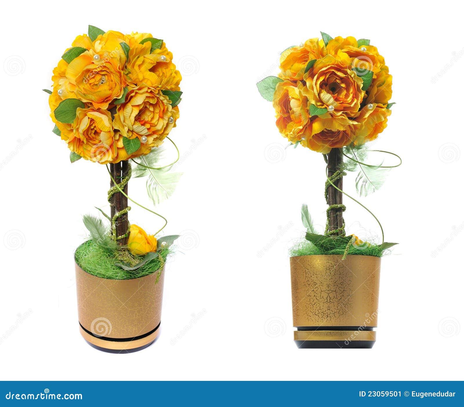 Maceta De Oro Con Las Flores Artificiales Imagen De