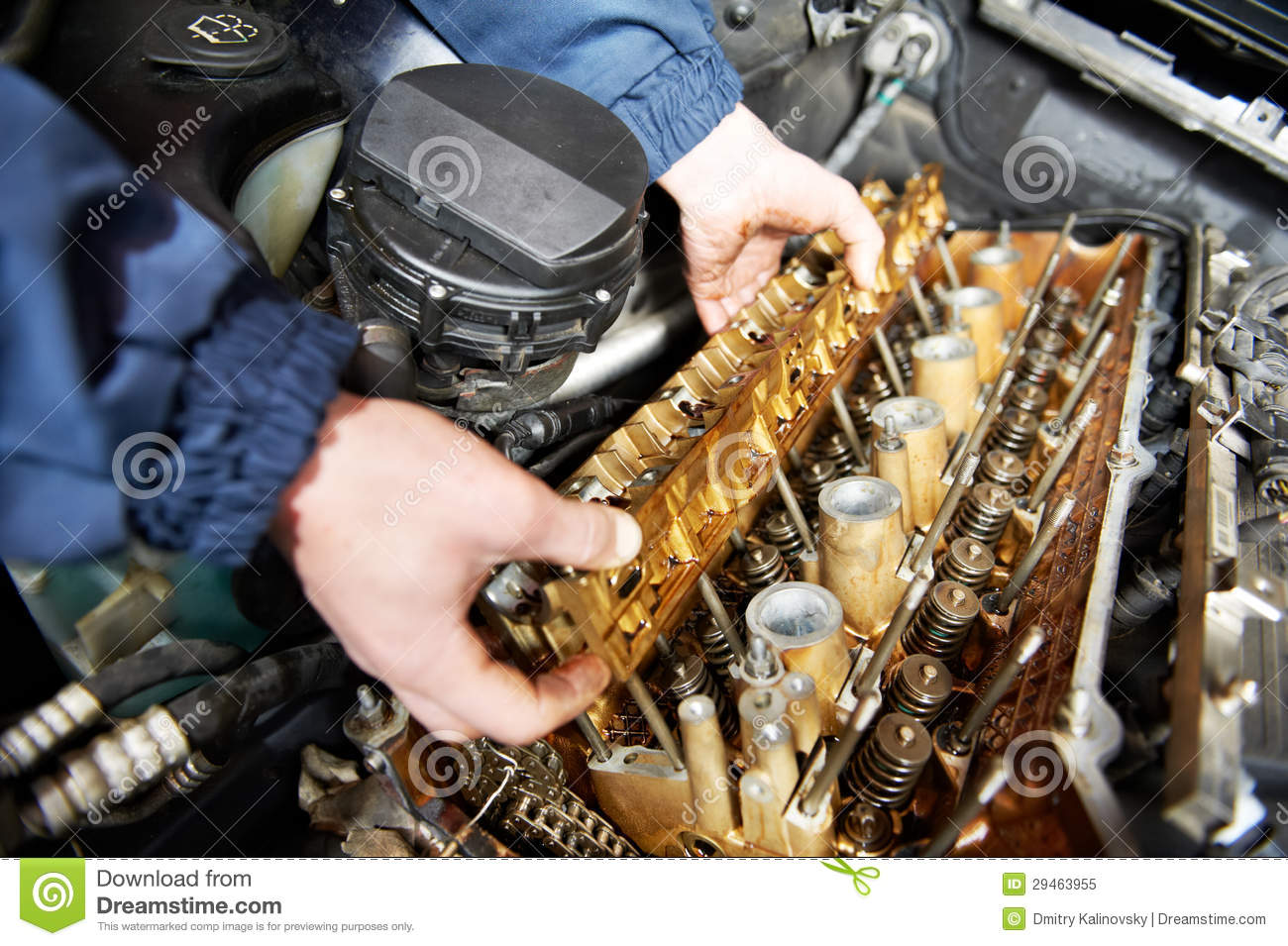Machanic repairman at automobile car engine repair stock Auto motor repair