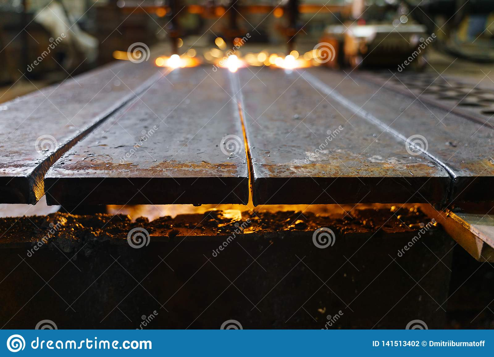 The machine cuts metal sheets with gas
