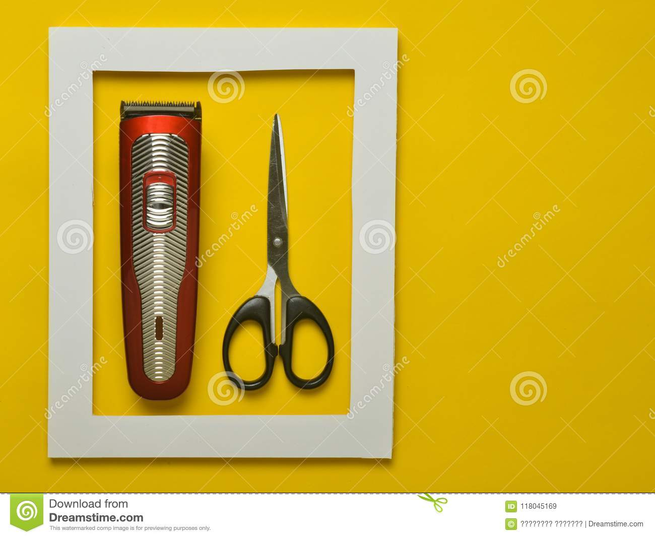 The Machine For A Hairstyle And Scissors In A White Frame On A