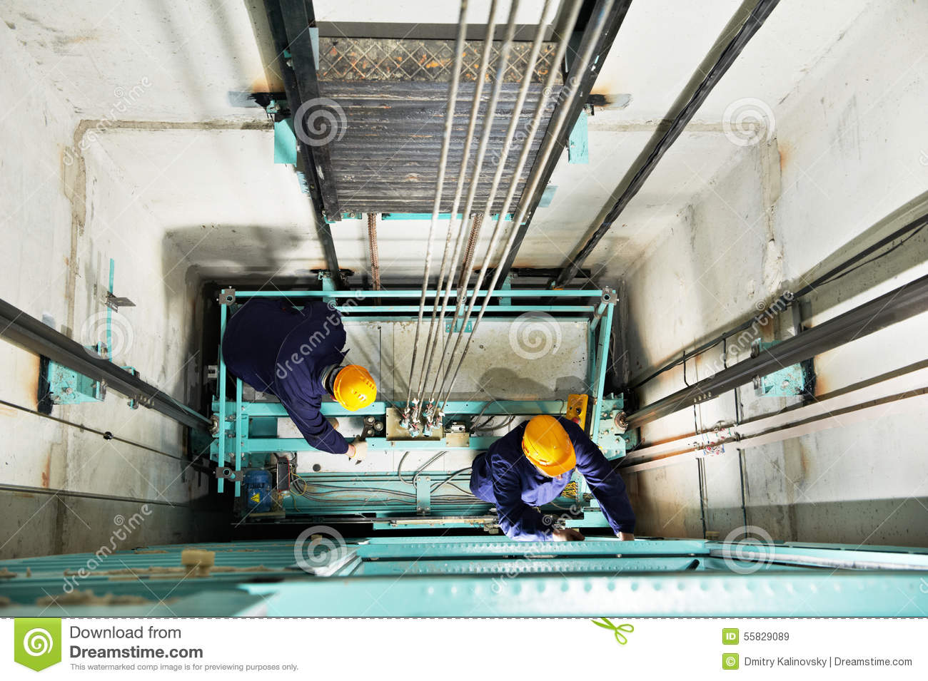 Machinist With Spanner Adjusting Lift Mechanism Stock Image - Image