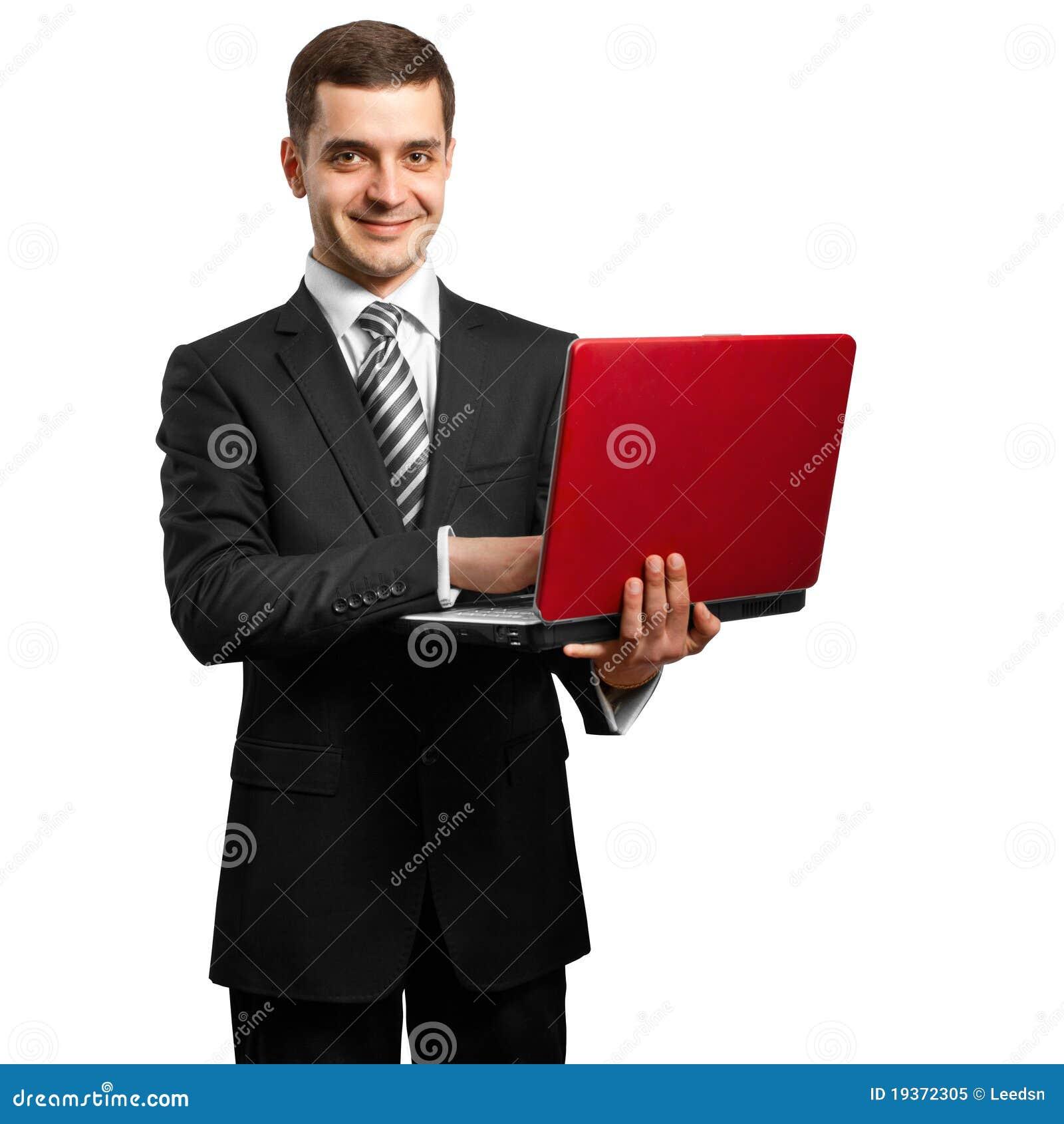 Macho no terno com o portátil em suas mãos