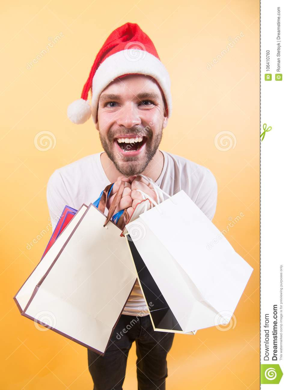 348657bbcc5c4 Macho Smile With Shopping Bags On Orange Background Stock Photo ...