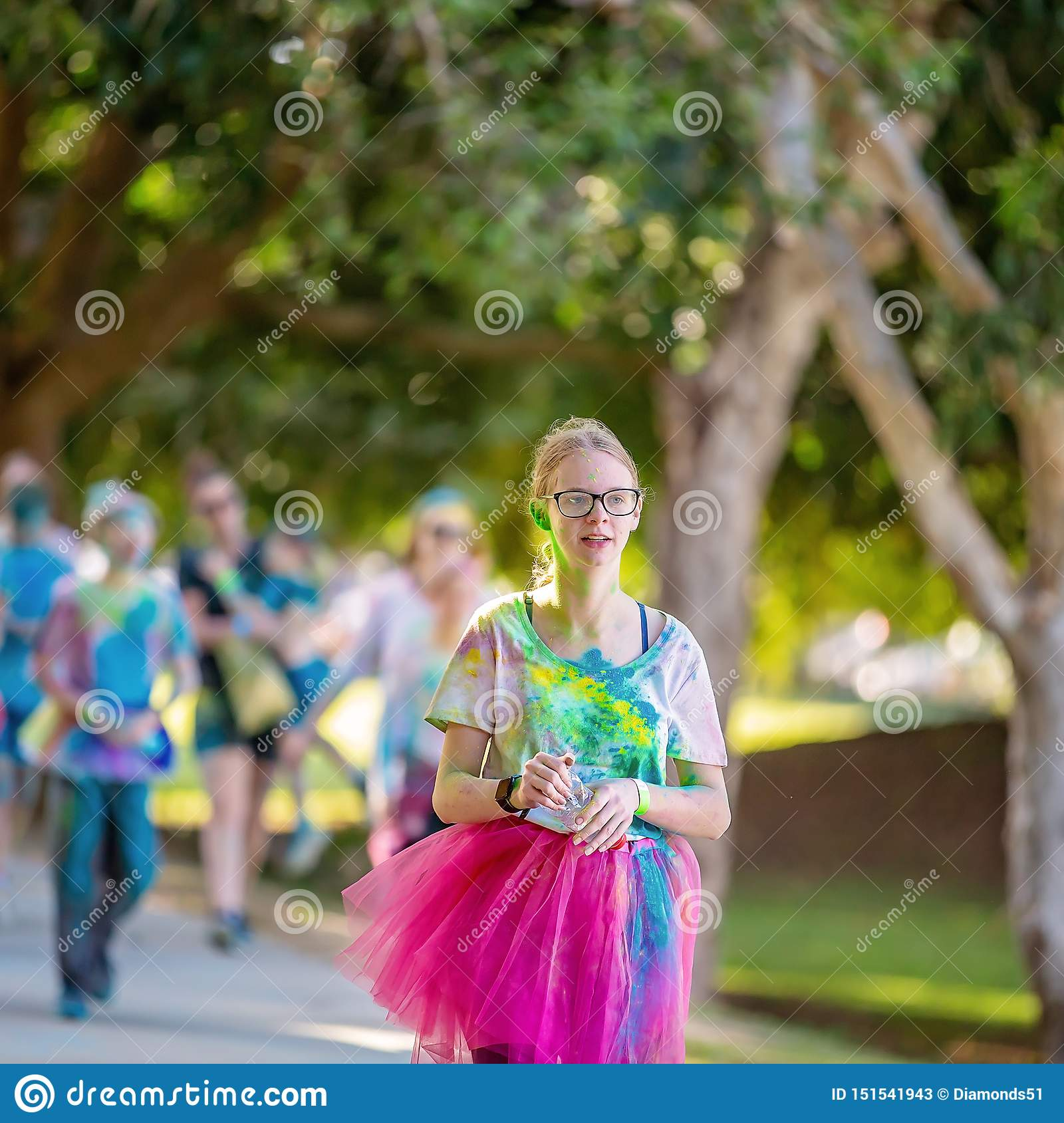 Young Girl Walks In Color Frenzy Fun Run