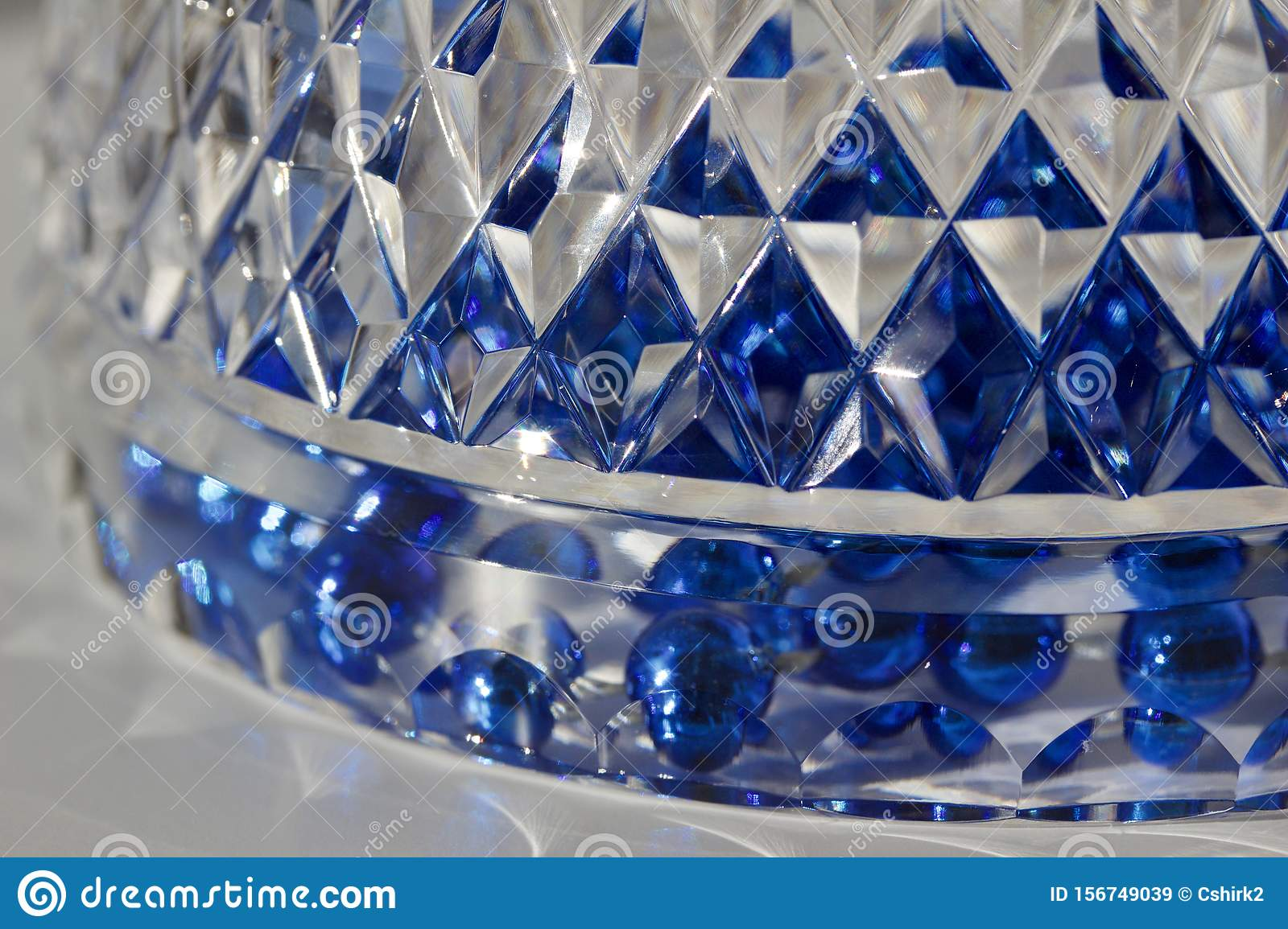 Macro abstract texture background of beautiful hand cut lead crystal glass with diamond cut facets