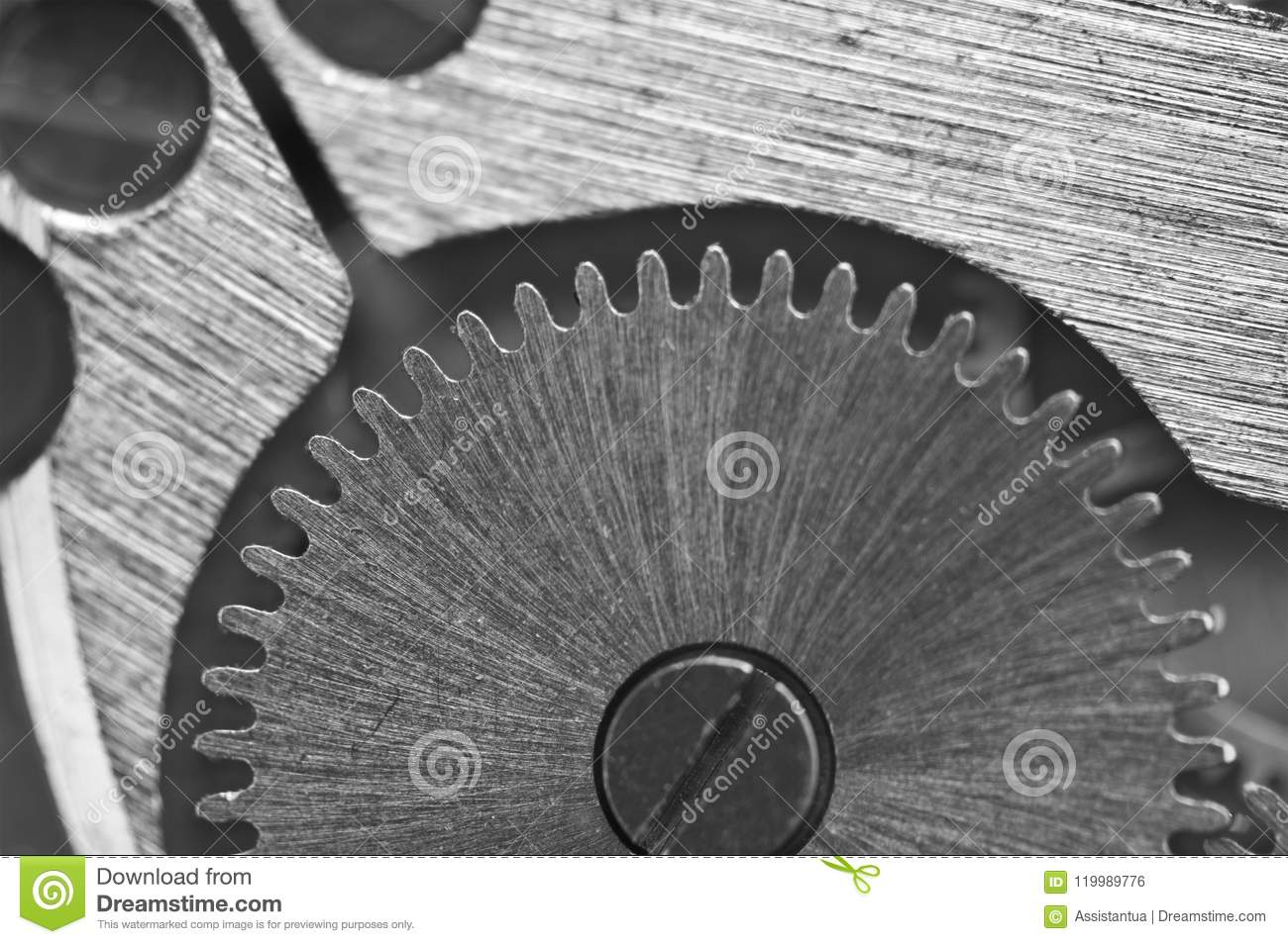 Macro. Black and white background with metal cogwheels close-up