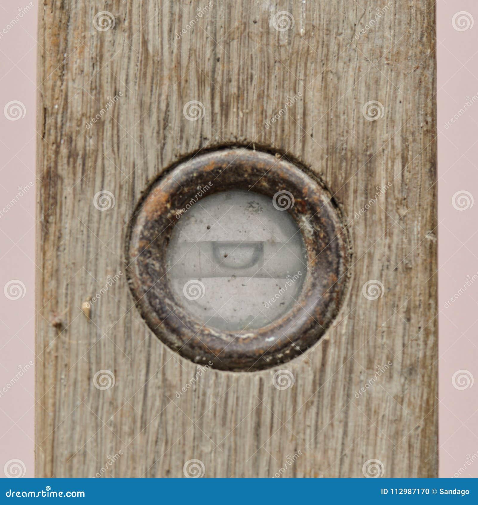 Old spirit level on wooden background