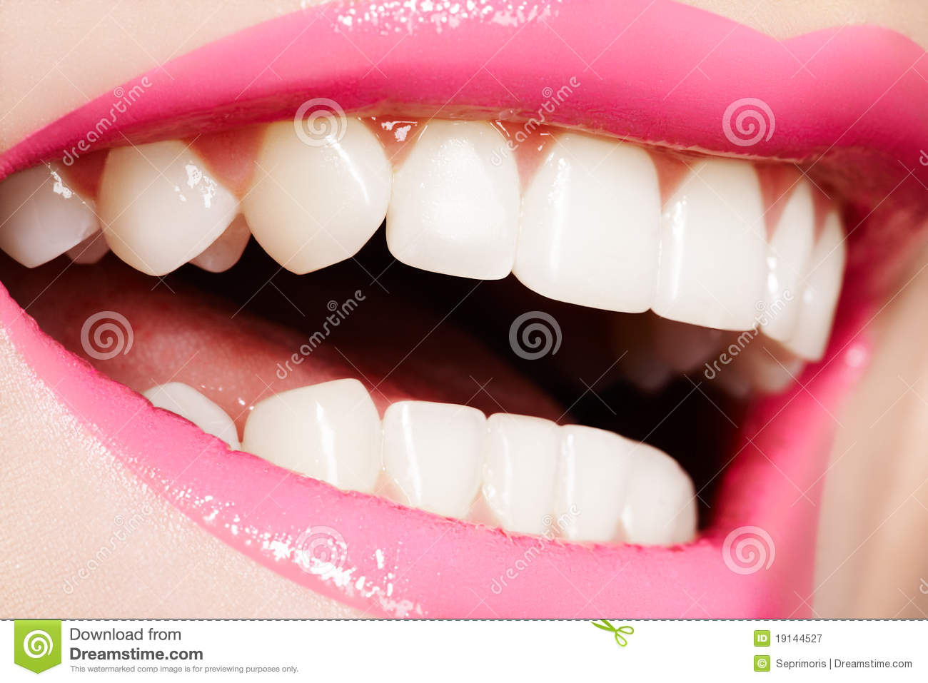 Macro happy female smile with healthy white teeth