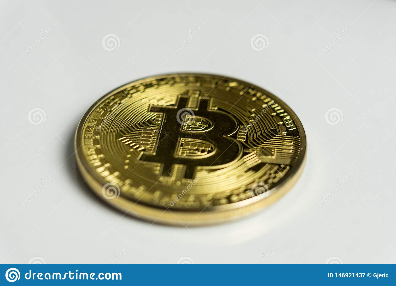 Face of the crypto currency golden bitcoin isolated on white background. The concept of virtual international currency