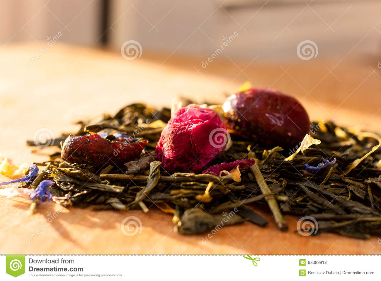 Macro photo of tea with a tea rose the composition of the heap of macro photo of tea with a tea rose the composition of the heap of tea roses and dried hibiscus flower located on a wooden board izmirmasajfo