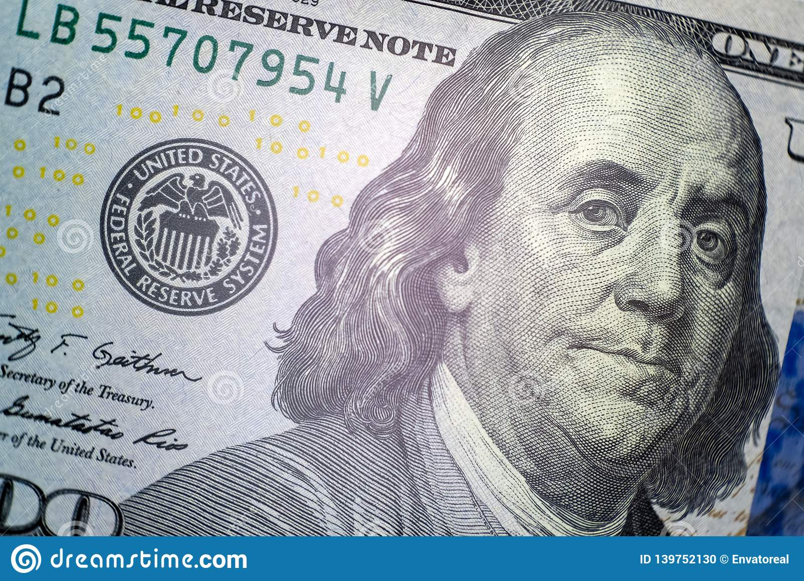 Portrait of Franklin. Close-up of a part of the US hundred dollar bill. Macro. Symbol of wealth and financial success