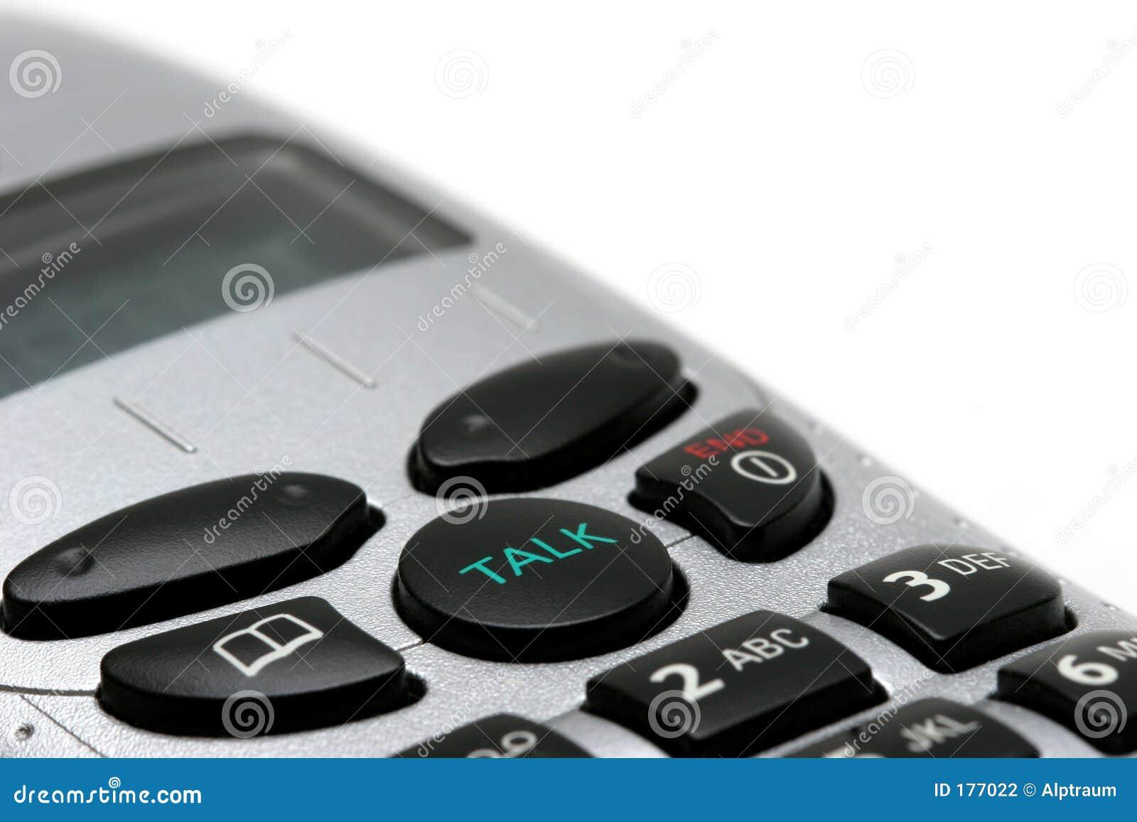 Macro senza fili del telefono su bianco