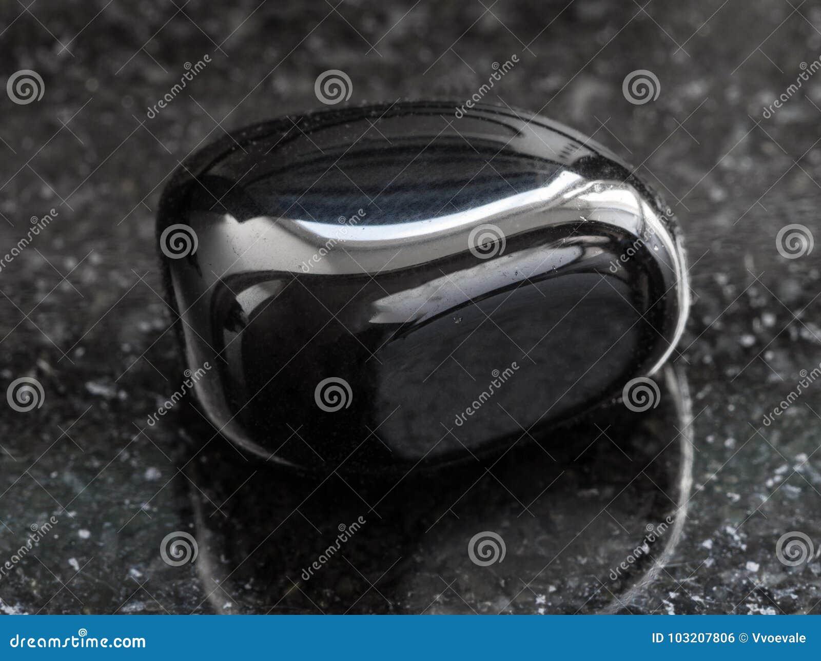 polished black Onyx gemstone on dark