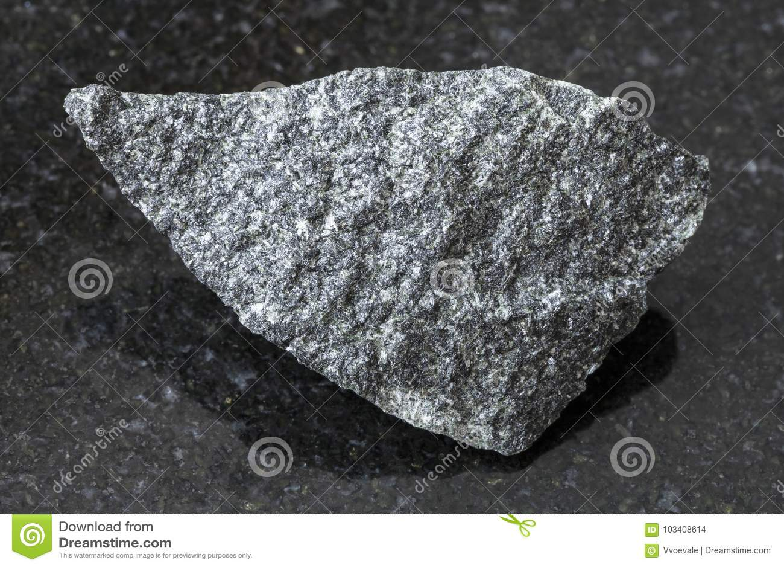 Raw Granite Stone : Raw dolerite stone on dark background stock photo image